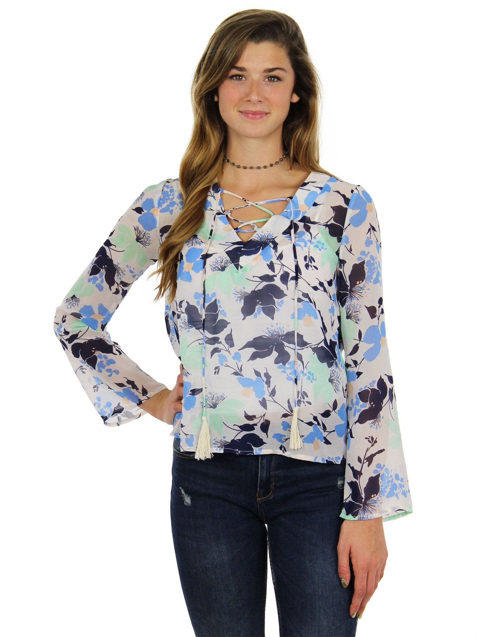 Woman wearing a top rental from Lucca Couture called Lace Up Tassle Long Sleeve Top