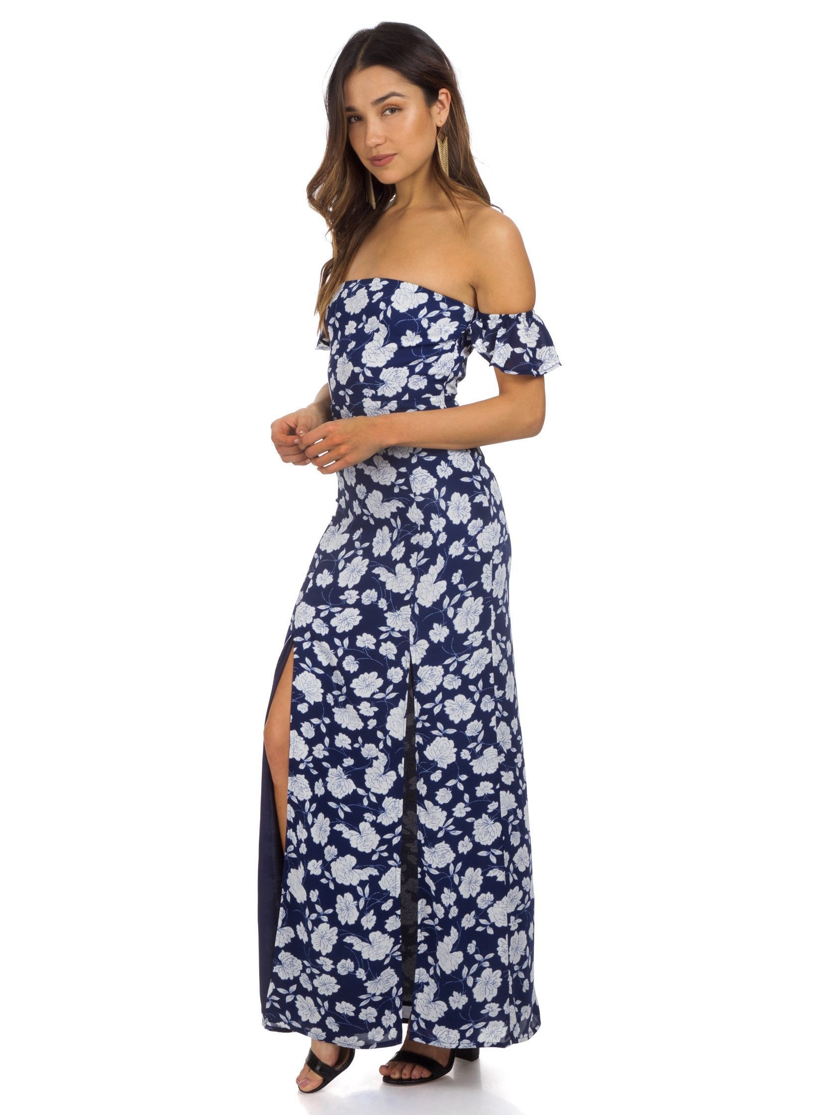 Woman wearing a dress rental from Lucca Couture called Off Shoulder Maxi Dress