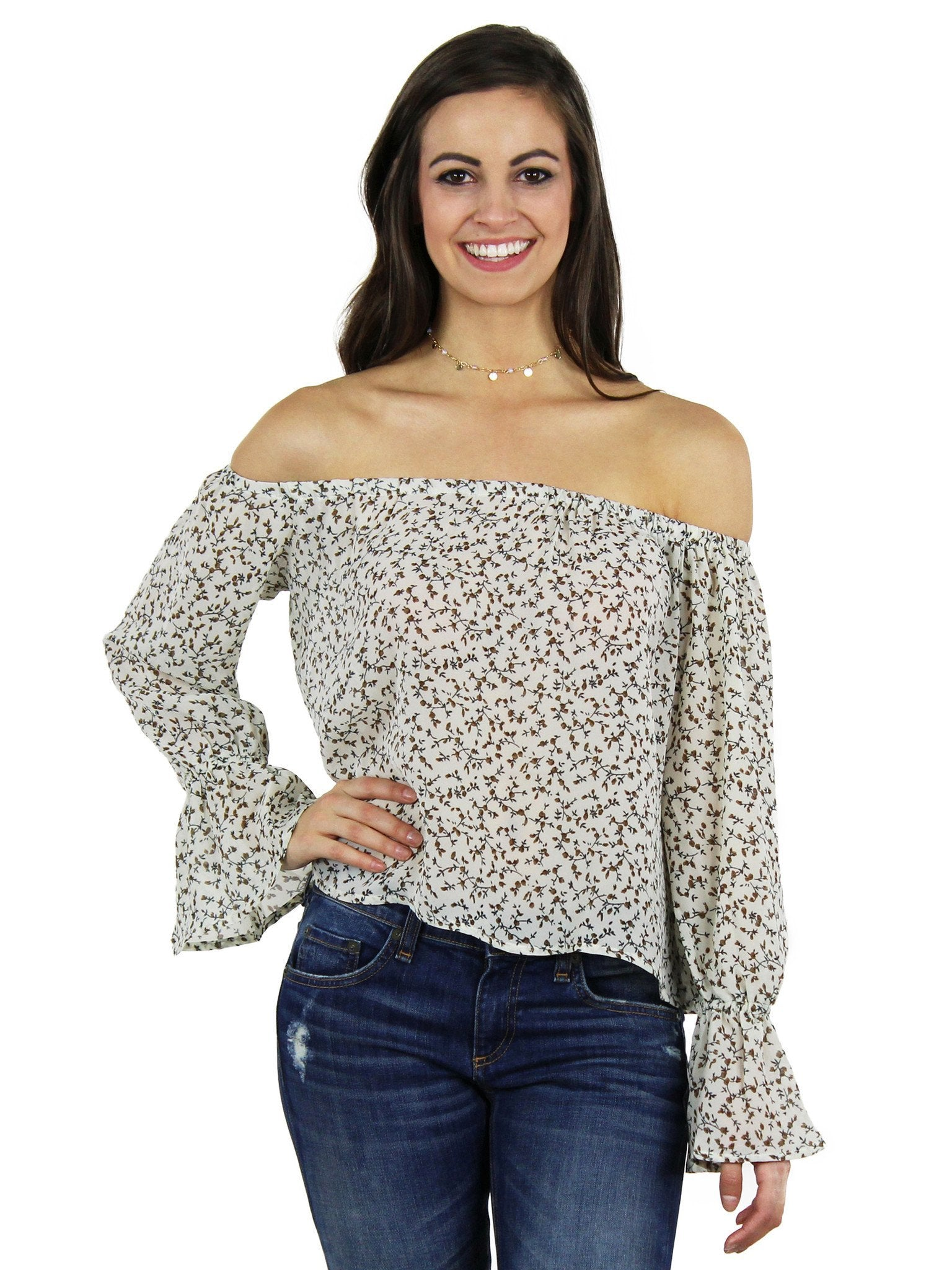 Woman wearing a top rental from Lucca Couture called Off Shoulder Ruffle Sleeve Top