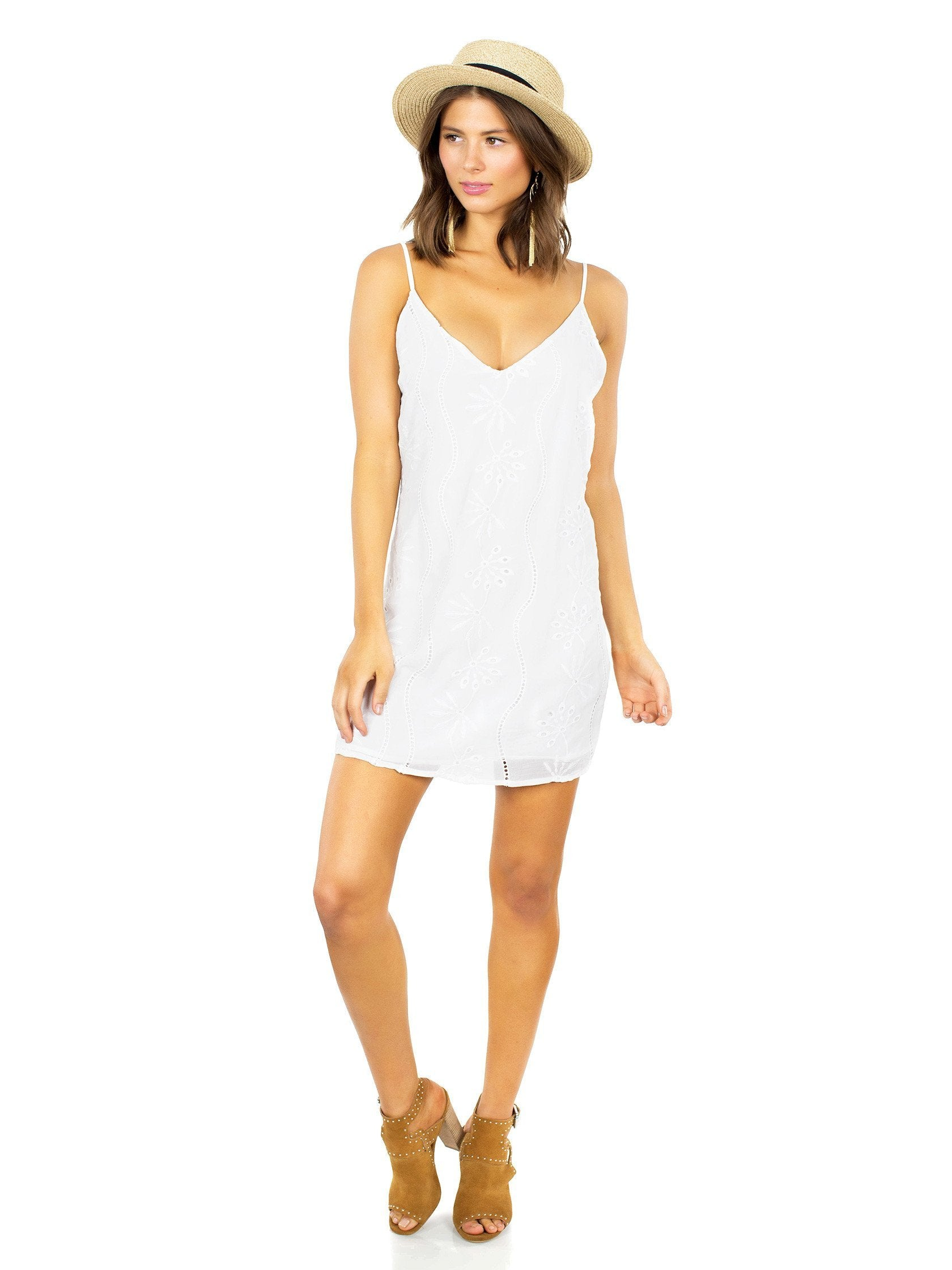 Women outfit in a dress rental from Lucca Couture called Soaking Up The Sun Mini Dress