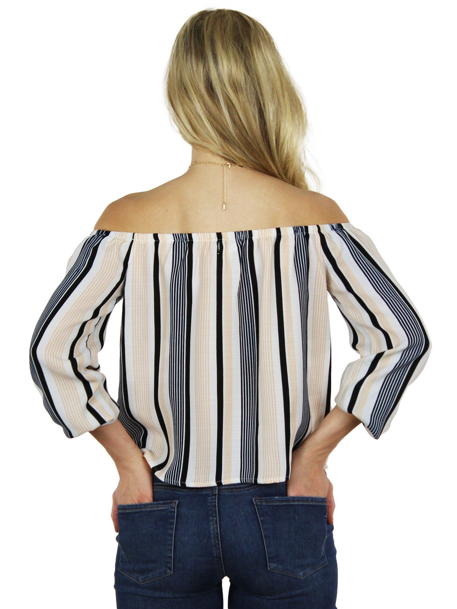 Women wearing a top rental from Lucca Couture called Stripes Are The New Black Blouse