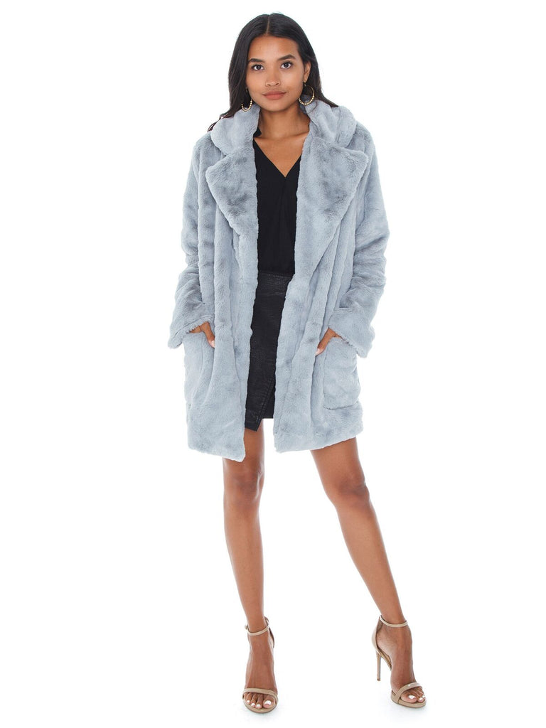 Women wearing a jacket rental from SAGE THE LABEL called Lucy In The Sky Fur Jacket