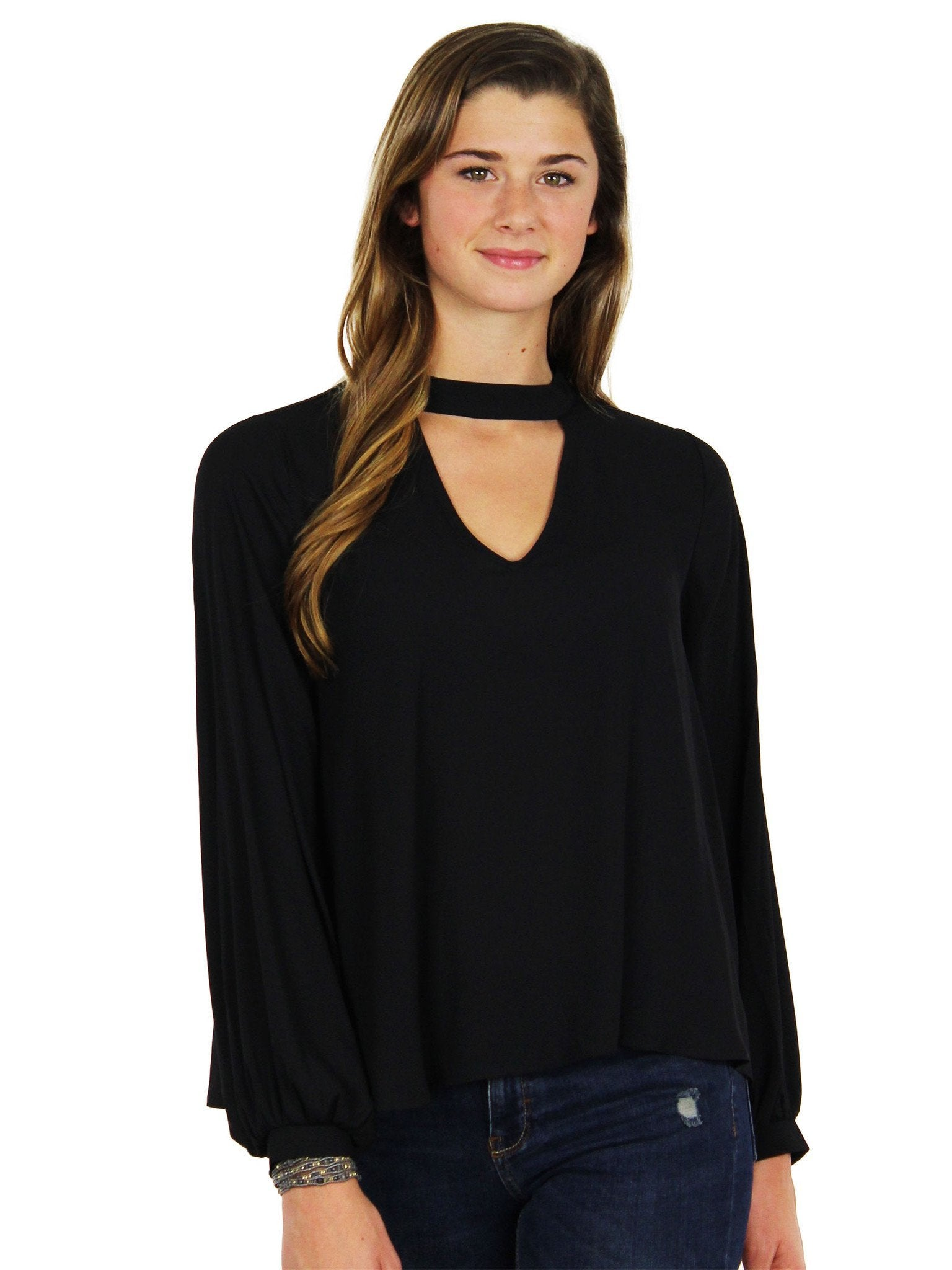 Woman wearing a top rental from Lush called Cut Out Long Sleeve Blouse