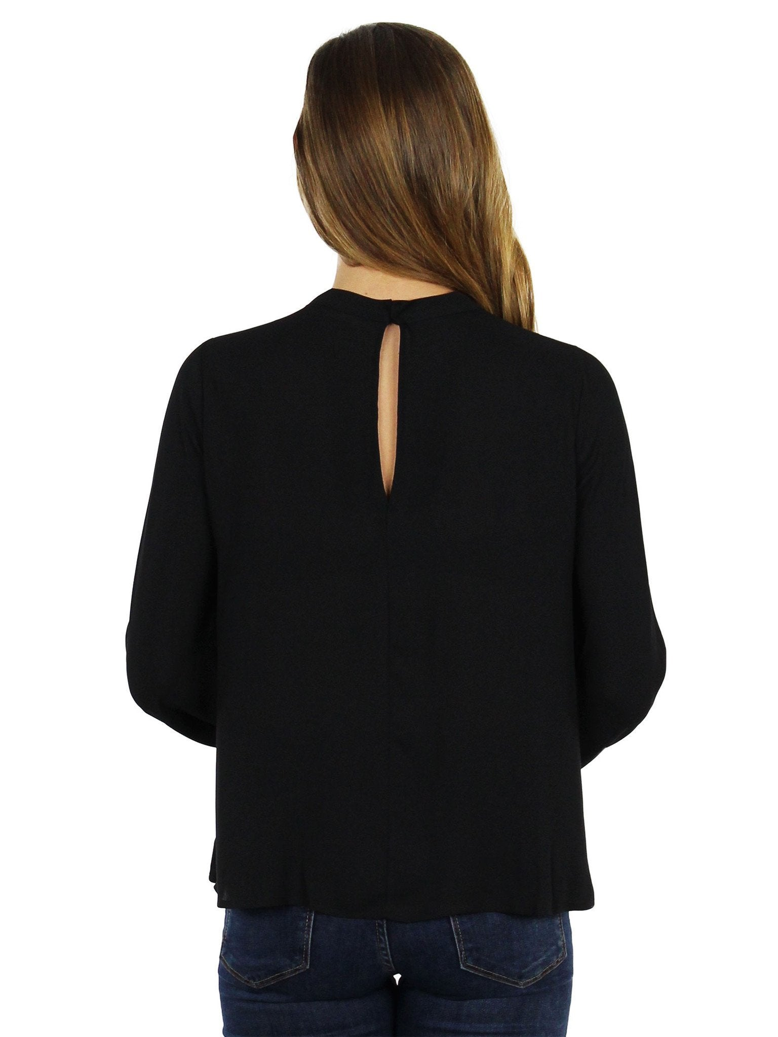 Women wearing a top rental from Lush called Cut Out Long Sleeve Blouse