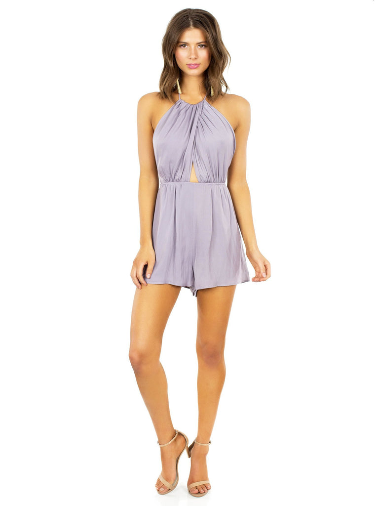 Woman wearing a romper rental from Lush called V-neck Ruffle Sleeve Top