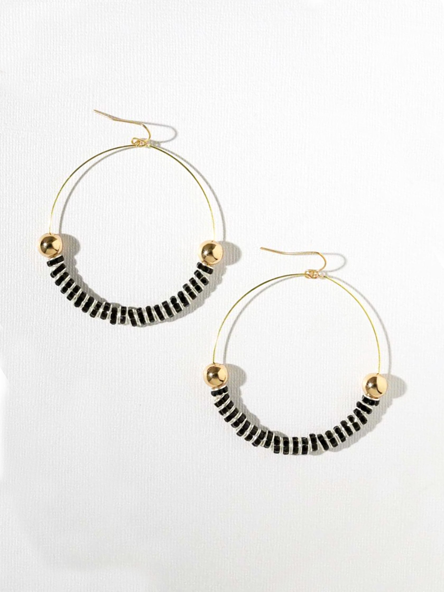 Women outfit in a earrings rental from Vanessa Mooney called Maddie Hoops