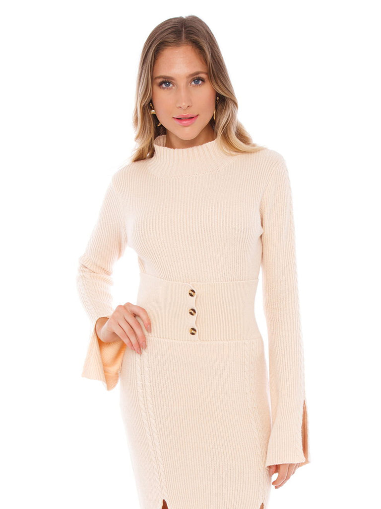 Girl wearing a sweater rental from FashionPass called Snap Button Tube Dress