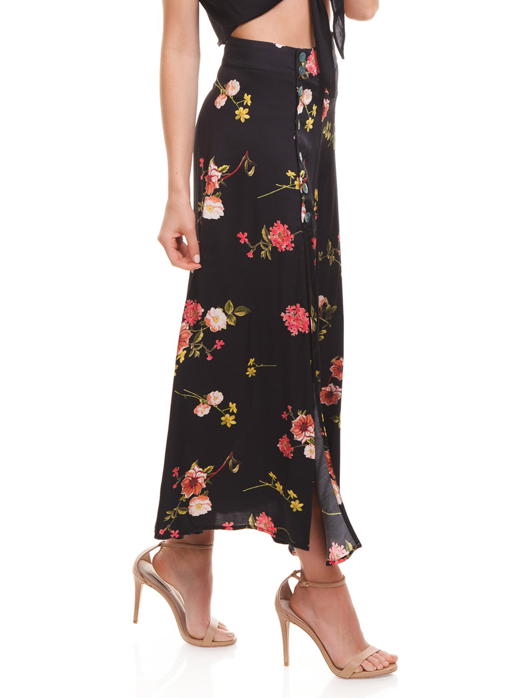 Women wearing a skirt rental from Capulet called Madie Midi Skirt
