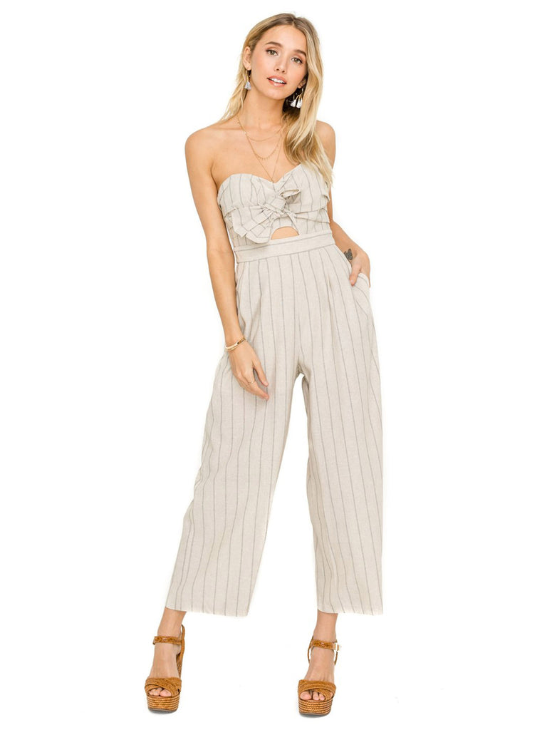 Woman wearing a jumpsuit rental from ASTR called Maren Bodysuit