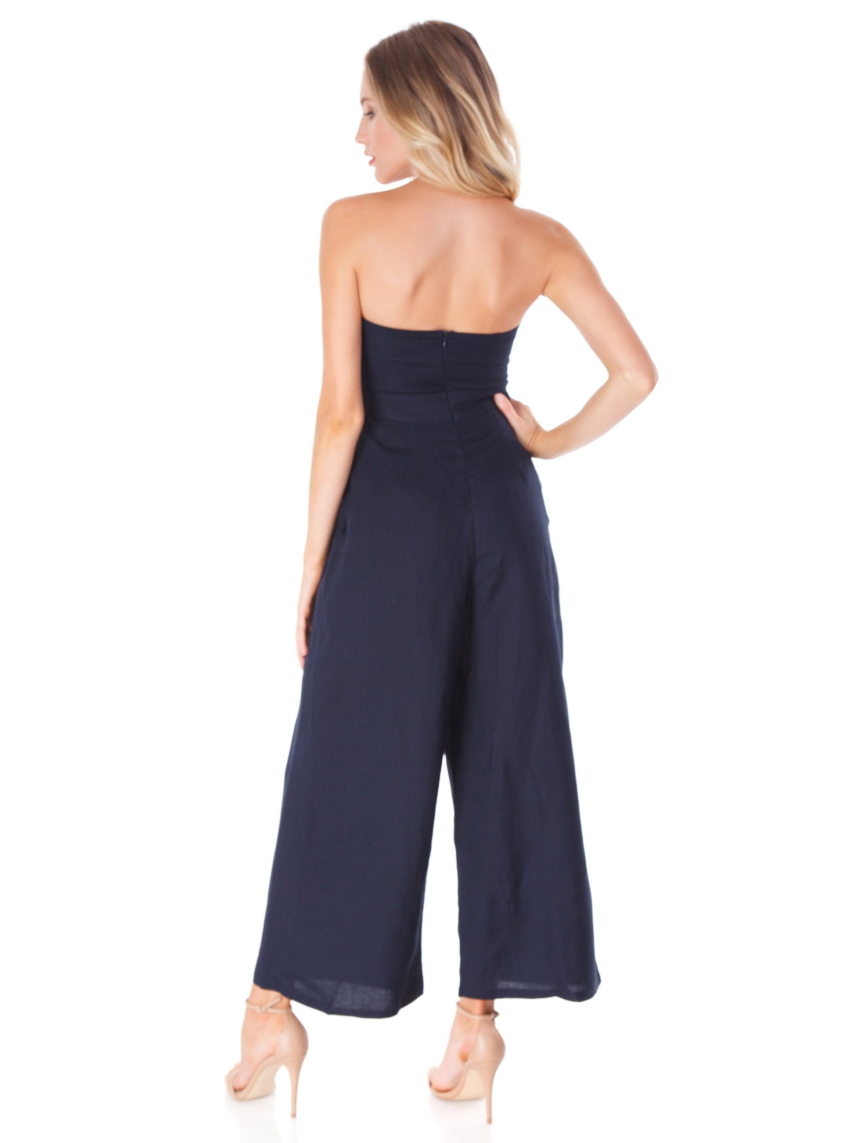 Women wearing a jumpsuit rental from ASTR called Mara Jumpsuit