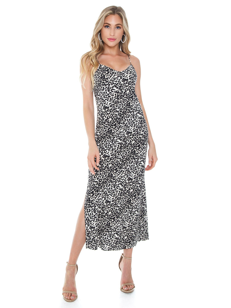 Girl wearing a dress rental from PISTOLA called Heat Wave Printed Maxi