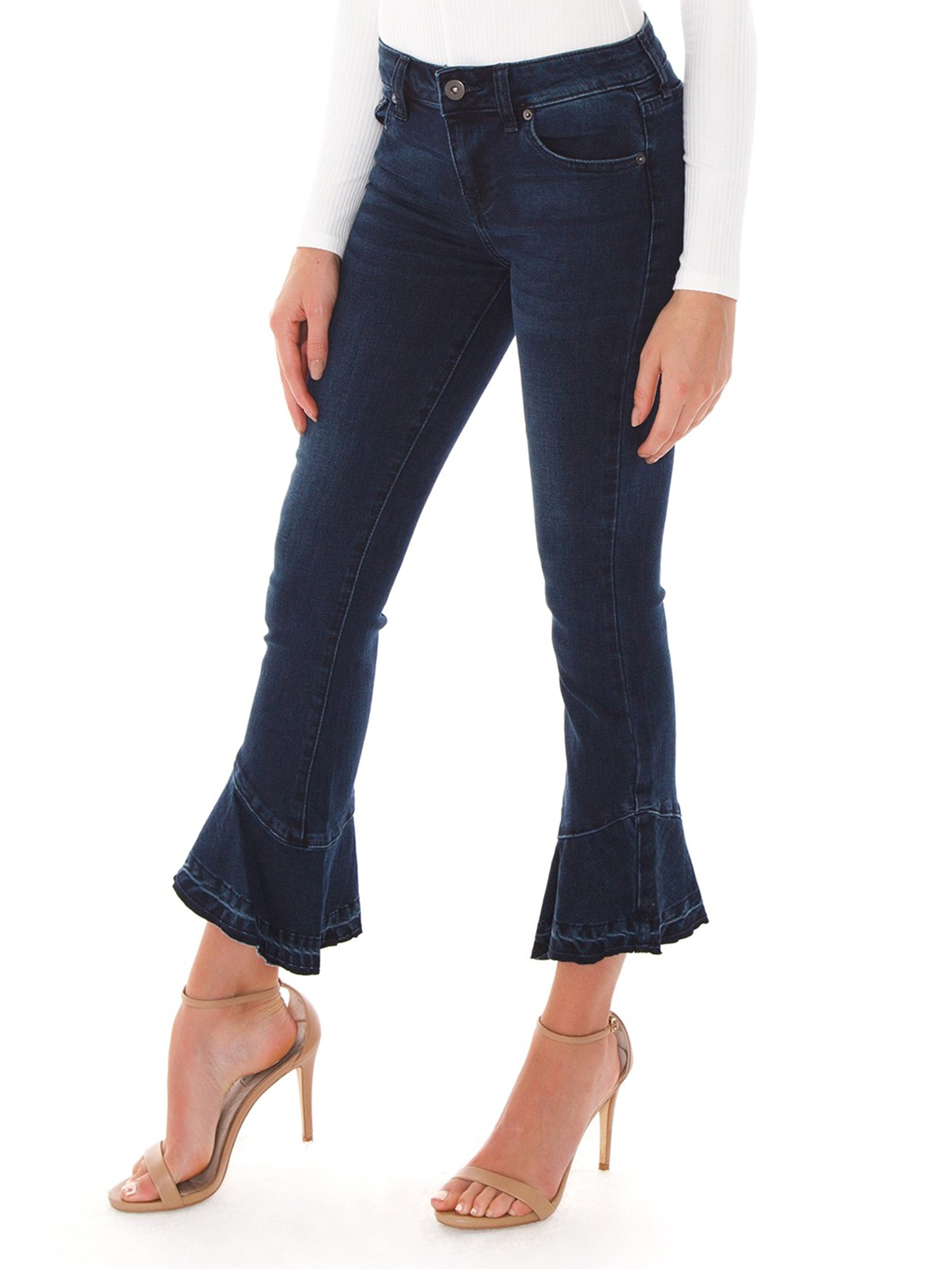 Women wearing a denim rental from PISTOLA called Marina Mide Rise Flounce Hem Jeans