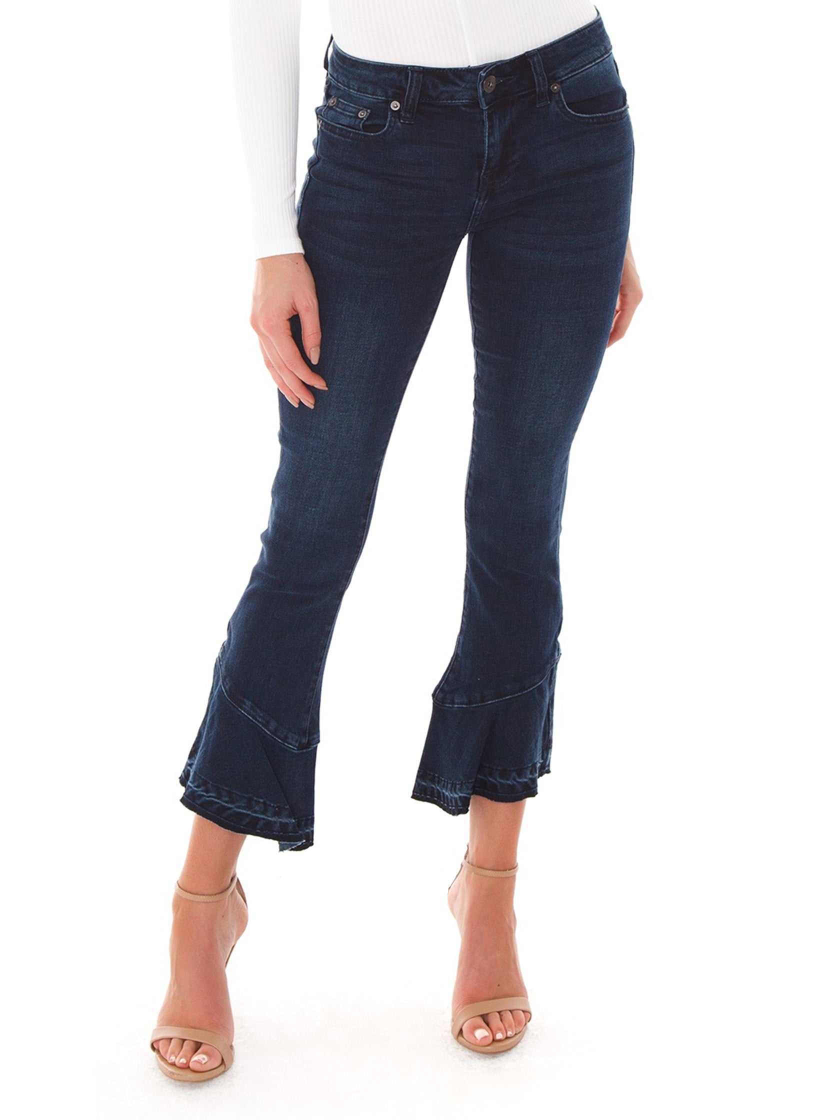 Woman wearing a denim rental from PISTOLA called Marina Mide Rise Flounce Hem Jeans