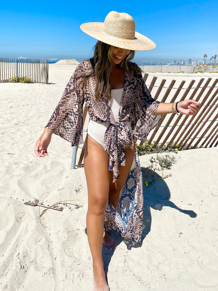 Women wearing a cover up rental from Show Me Your Mumu called Double Crossed Knit