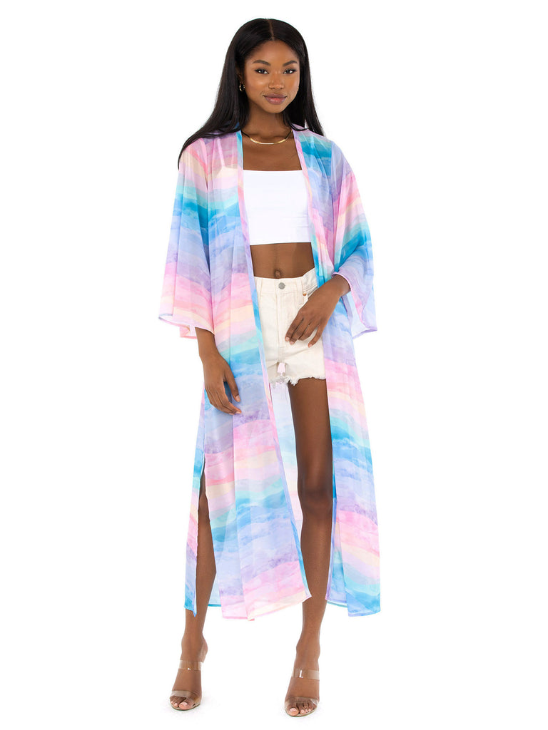 Women wearing a cover up rental from Show Me Your Mumu called Rosalie Crop Top