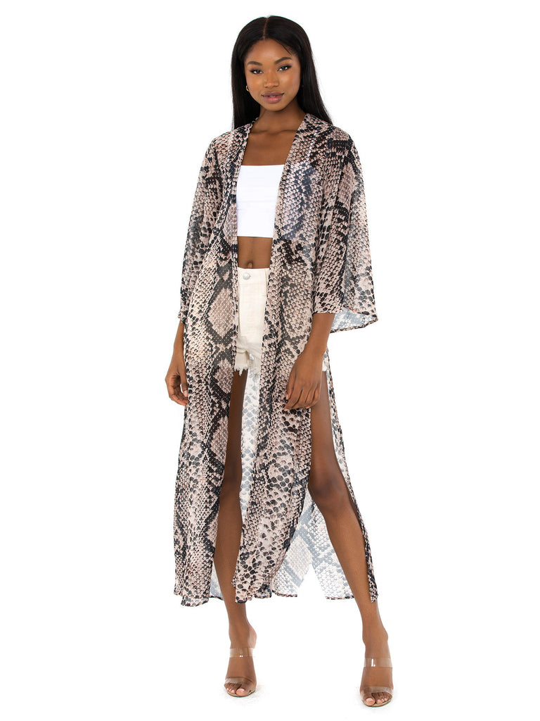 Girl outfit in a cover up rental from Show Me Your Mumu called Faux Leather Jogger