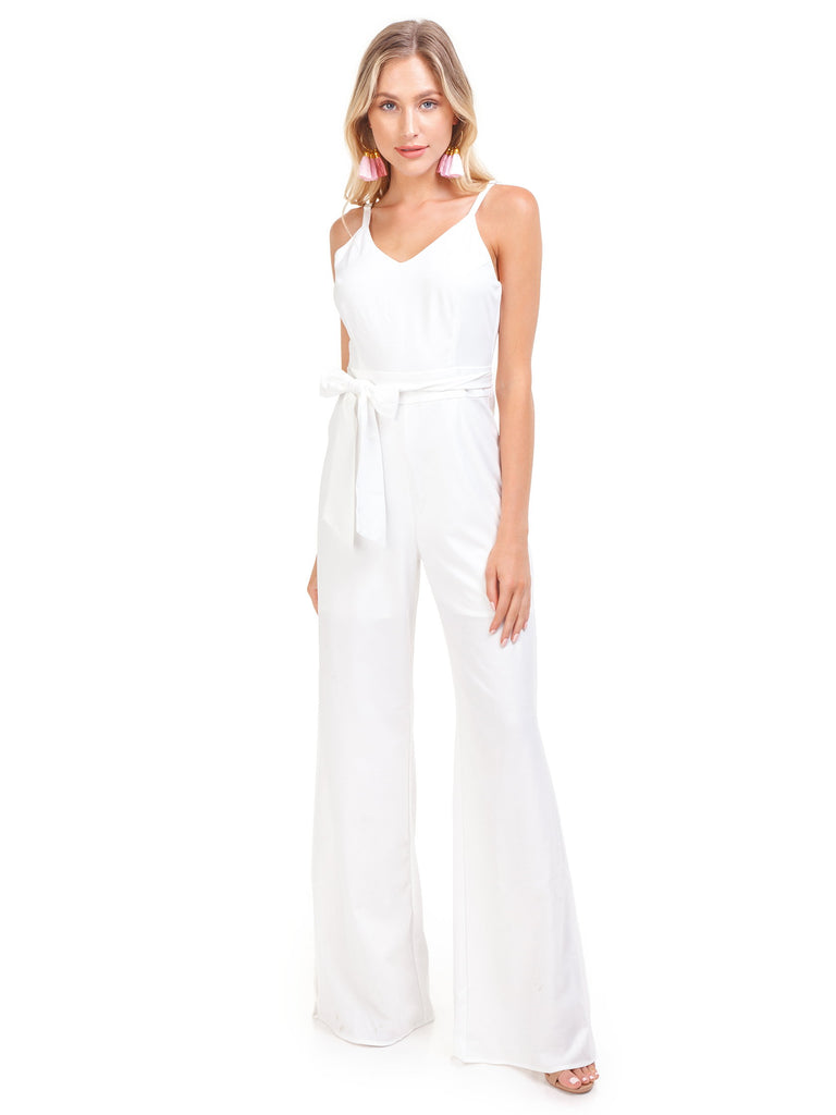 Woman wearing a jumpsuit rental from Line & Dot called Chiara Ruffled Top