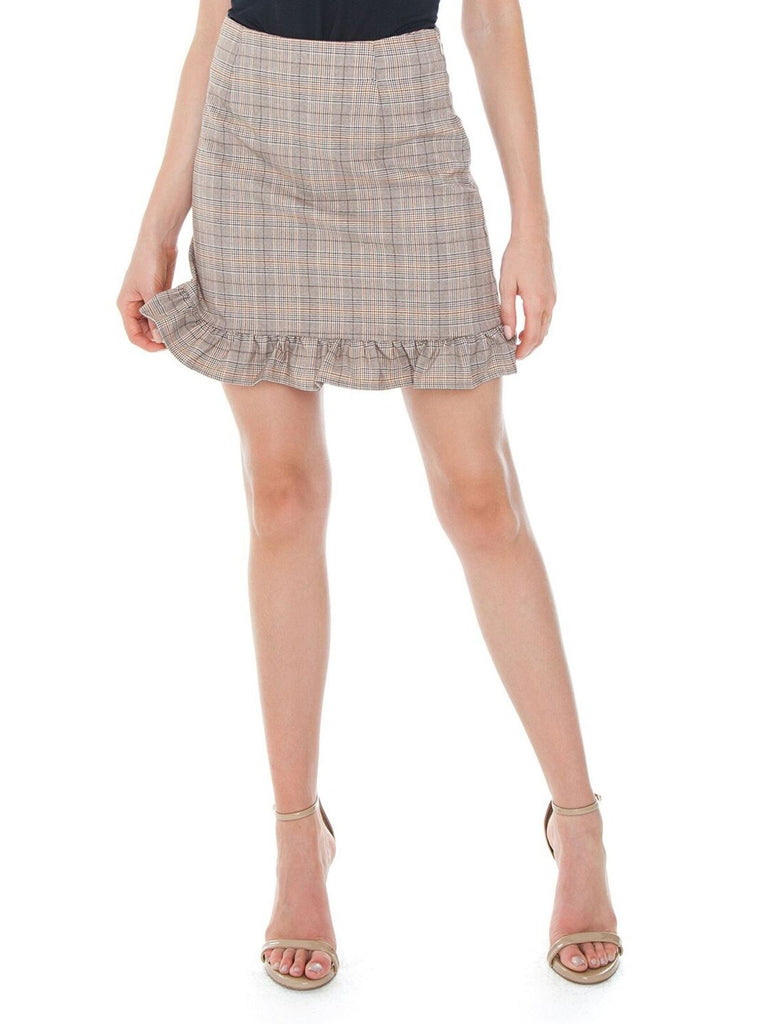 Woman wearing a skirt rental from Cupcakes and Cashmere called Say It To Me Bodysuit