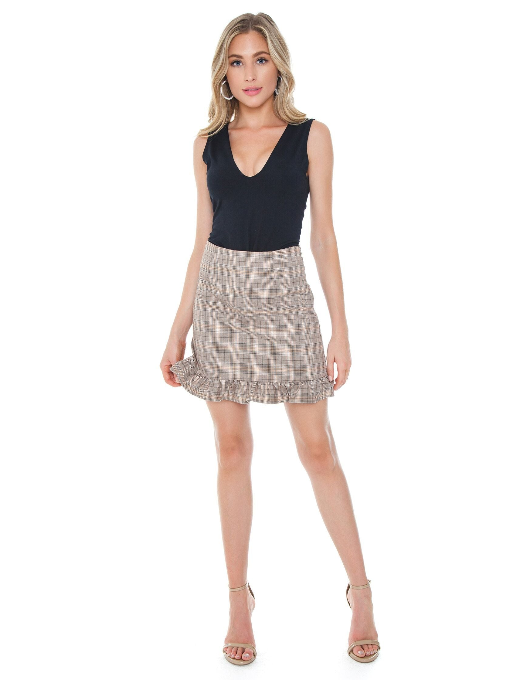 Girl wearing a skirt rental from Cupcakes and Cashmere called Matilda Skirt