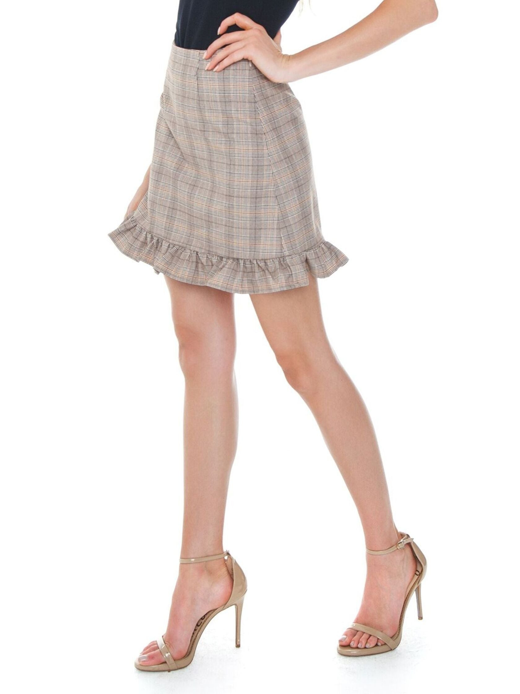 Women wearing a skirt rental from Cupcakes and Cashmere called Matilda Skirt