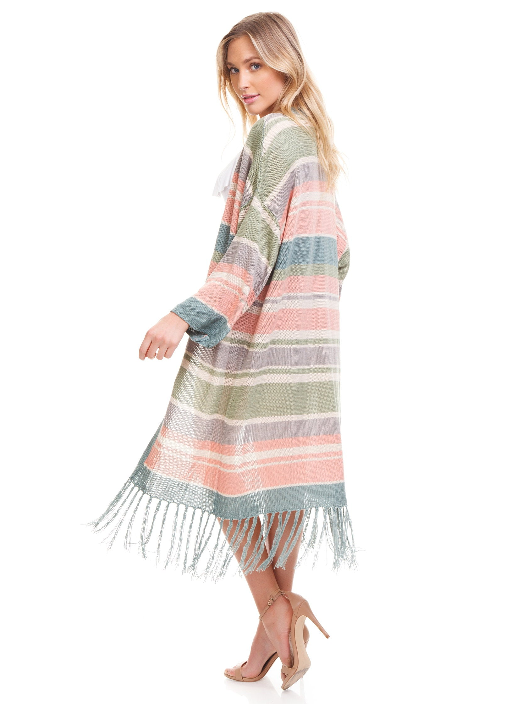 Women wearing a sweater rental from Show Me Your Mumu called Maude Fringe Cardigan