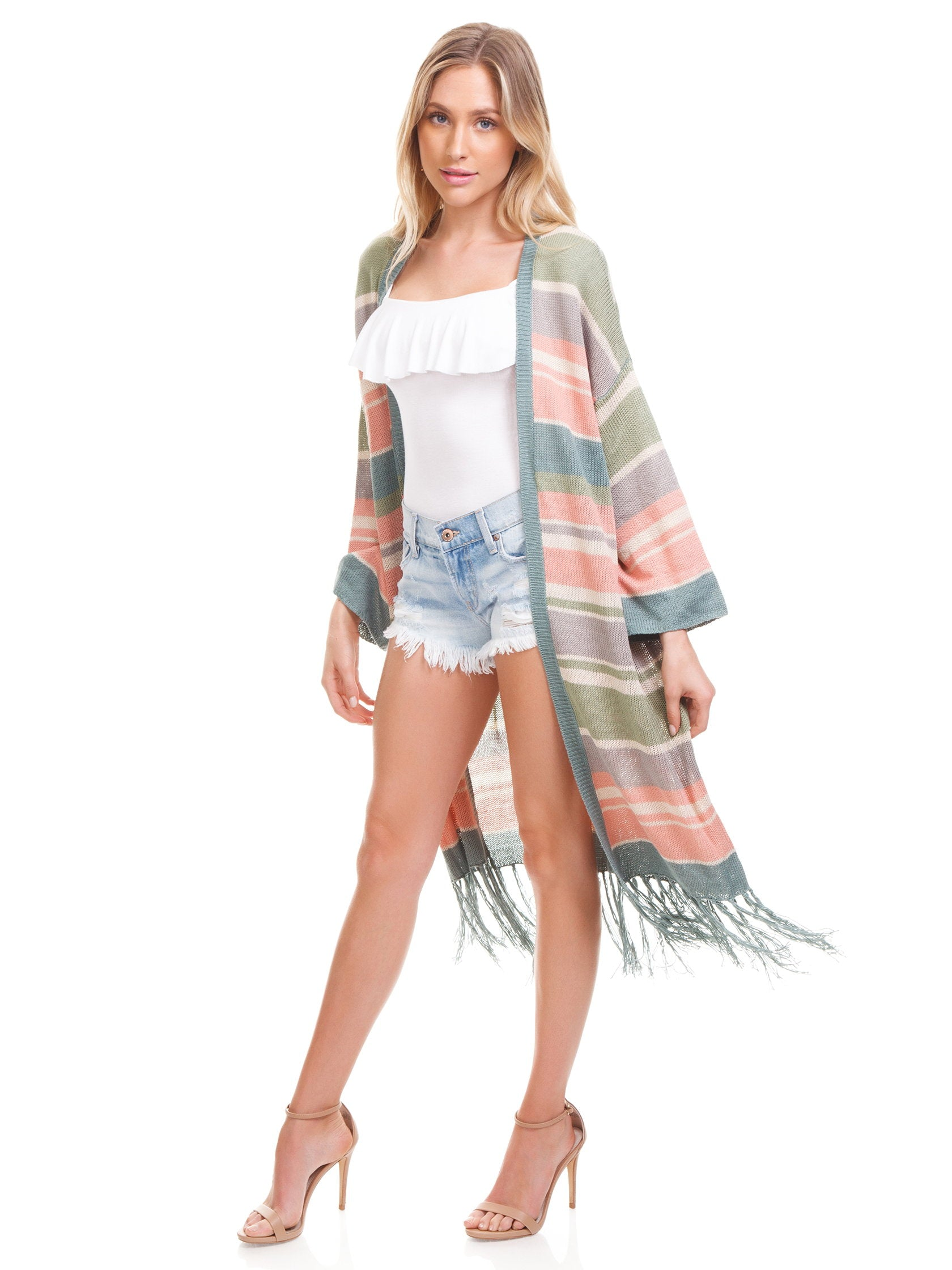 Girl outfit in a sweater rental from Show Me Your Mumu called Maude Fringe Cardigan