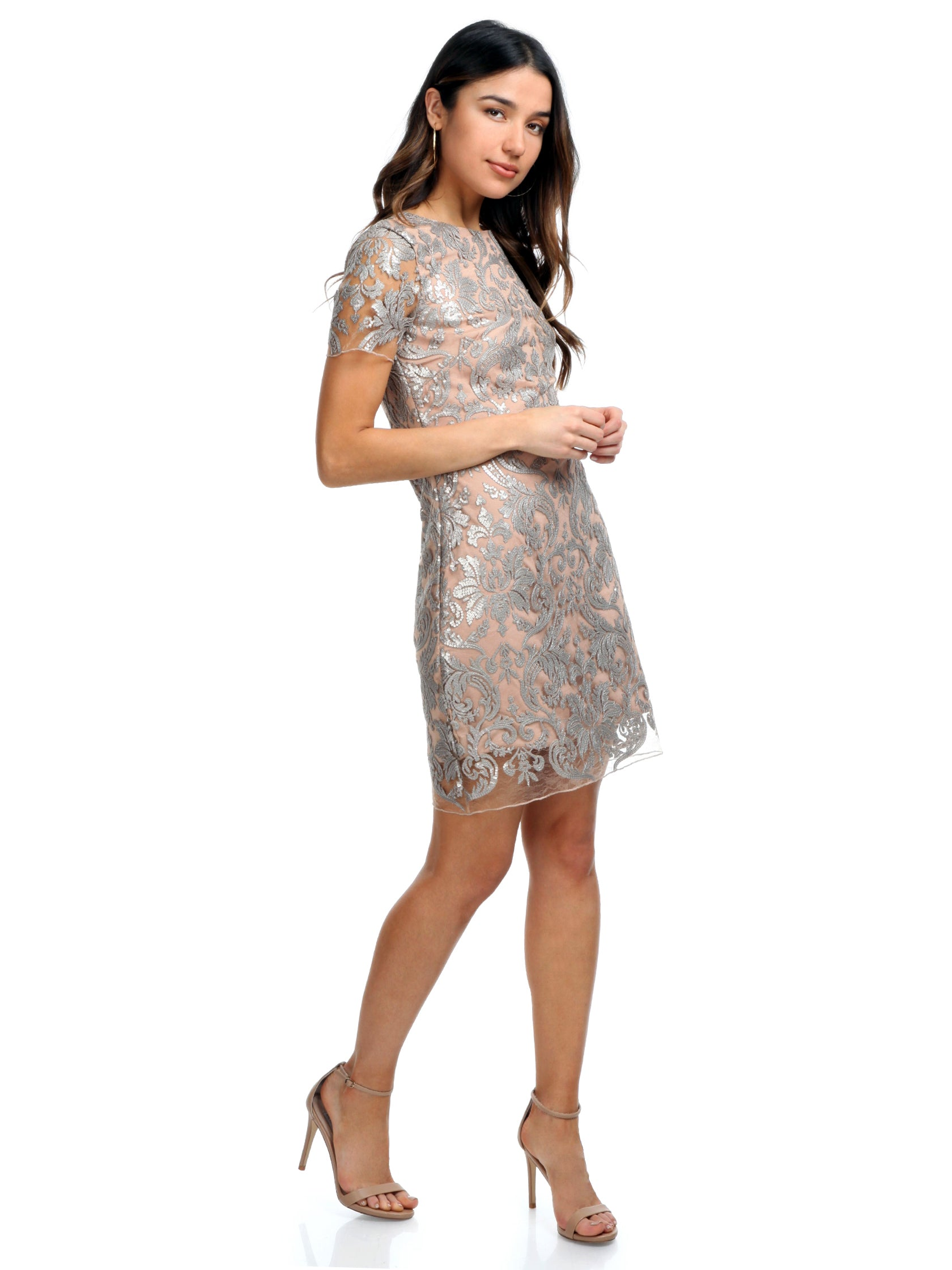 Woman wearing a dress rental from Dress the Population called Megan Sequin Lace Shift Dress