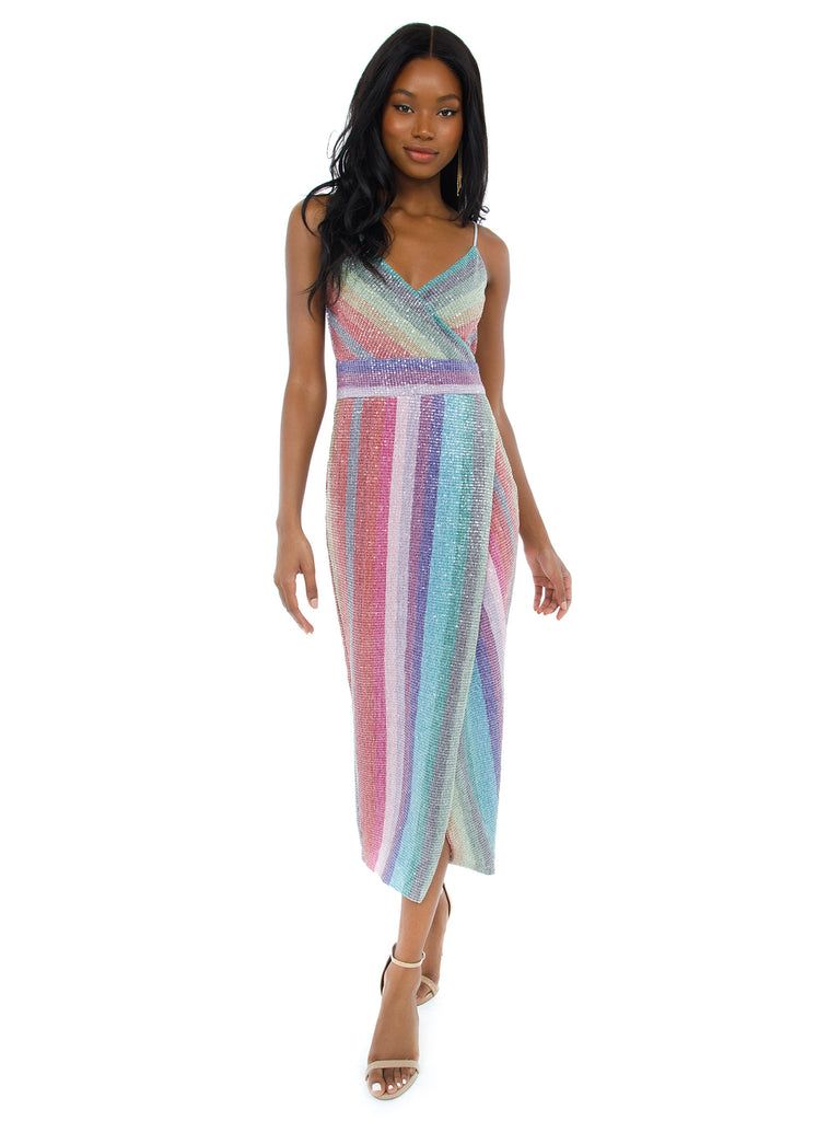 Woman wearing a dress rental from Saylor called Calypso Midi Dress