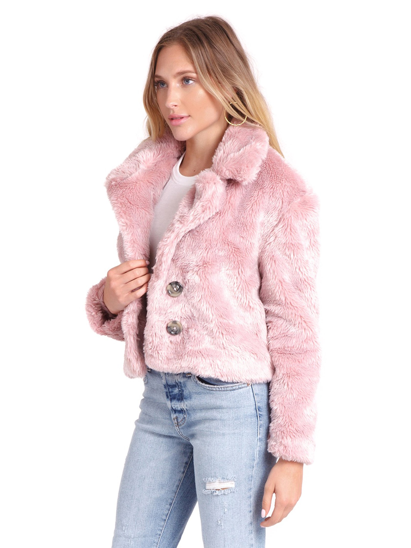 Women wearing a jacket rental from Free People called Mena Fur Coat