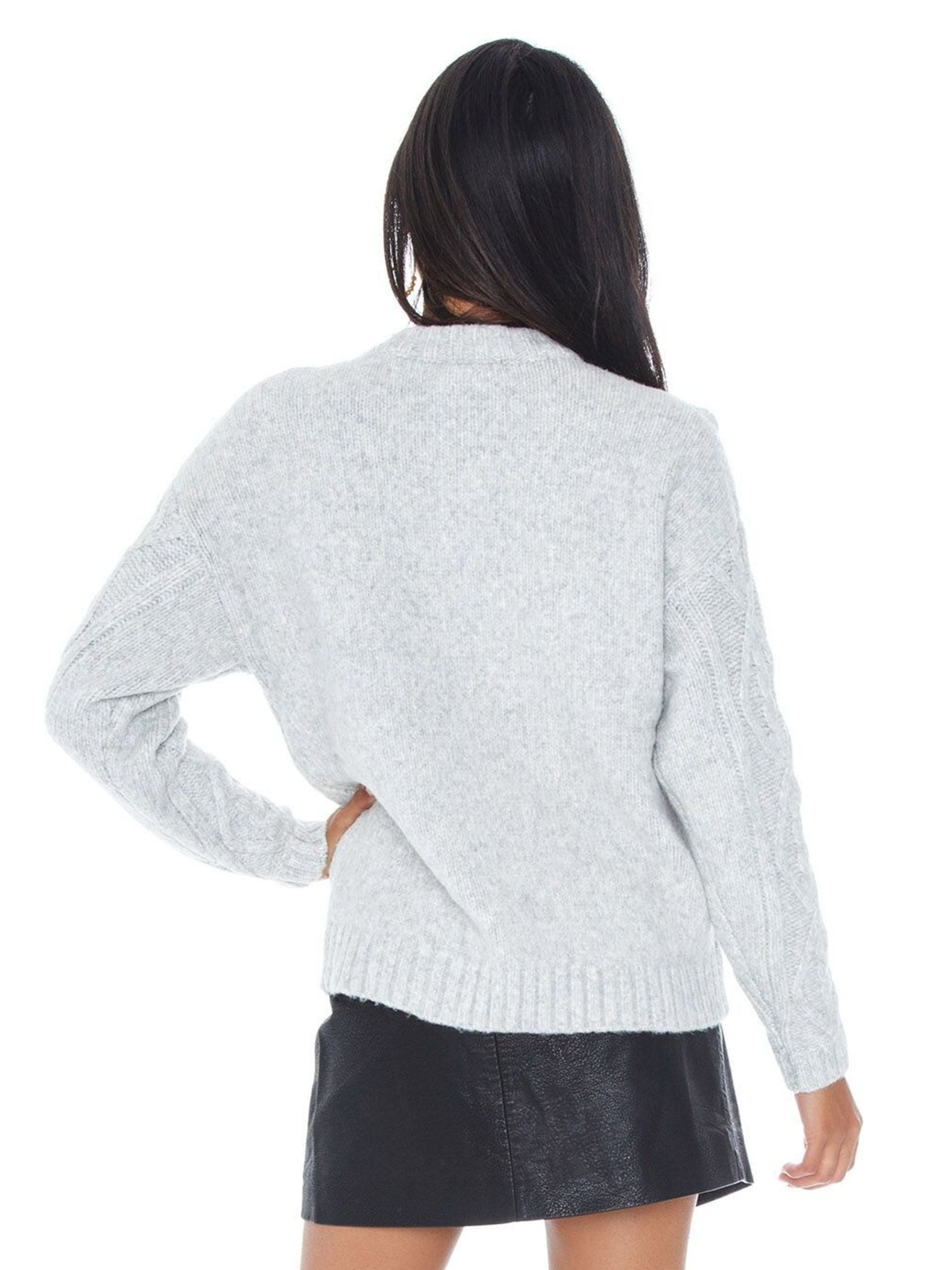 Women outfit in a sweater rental from Line & Dot called Mila Sweater