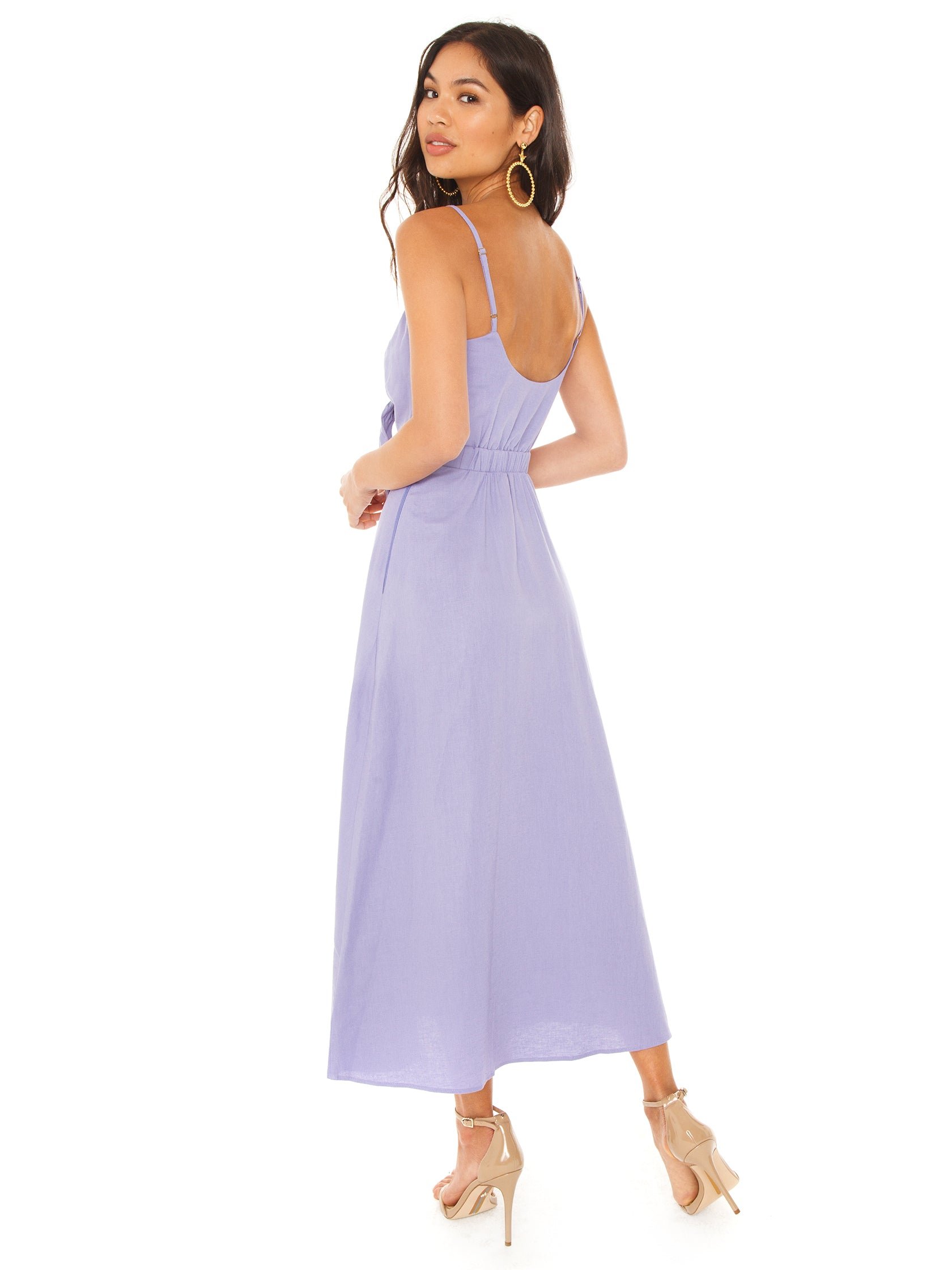 Women wearing a dress rental from Show Me Your Mumu called Moby Tie Maxi