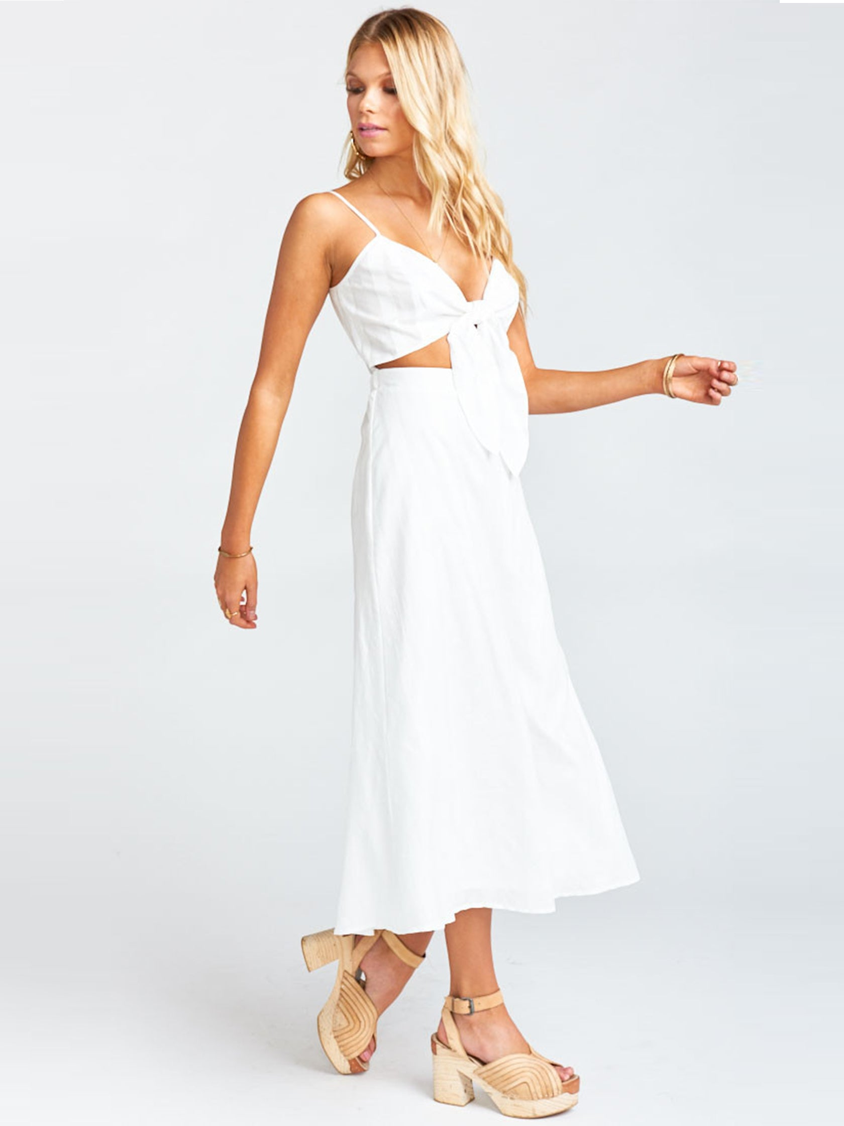 Women wearing a dress rental from Show Me Your Mumu called Moby Tie Maxi - White Tulip