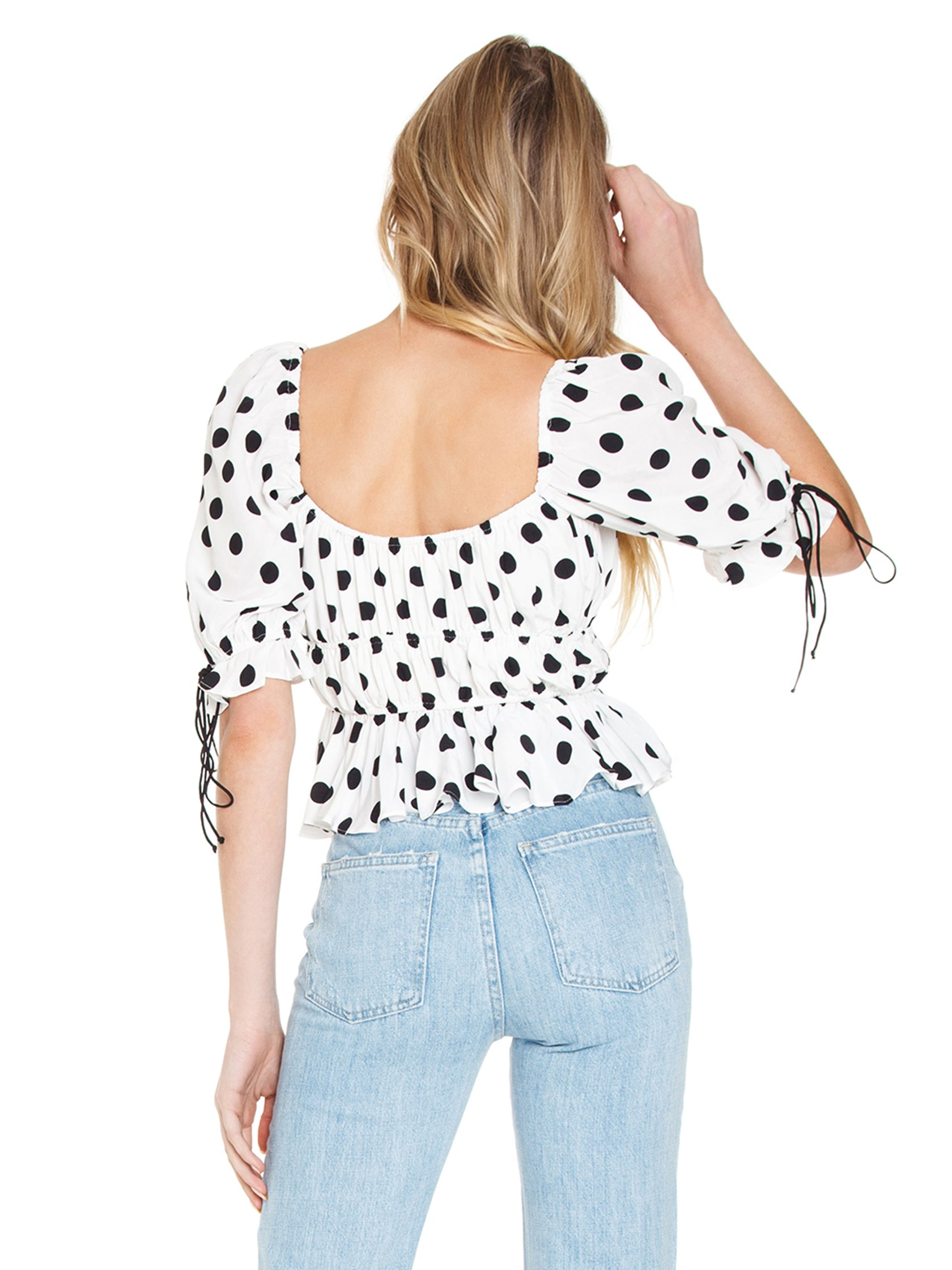 Women outfit in a top rental from For Love & Lemons called Mochi Summer Blouse