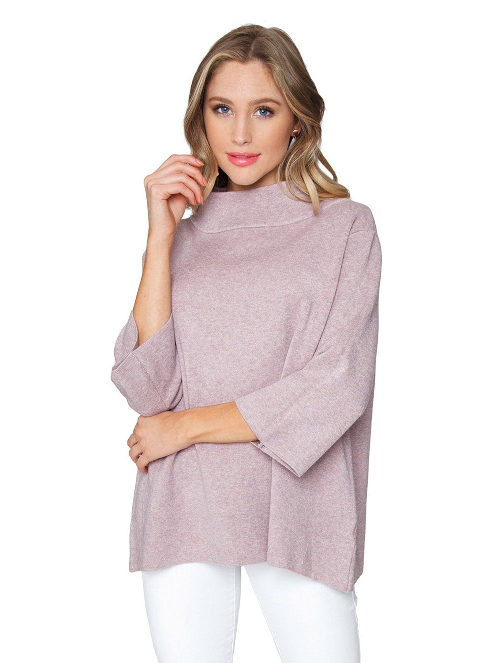 Woman wearing a sweater rental from FashionPass called Mock Neck Pullover Sweater