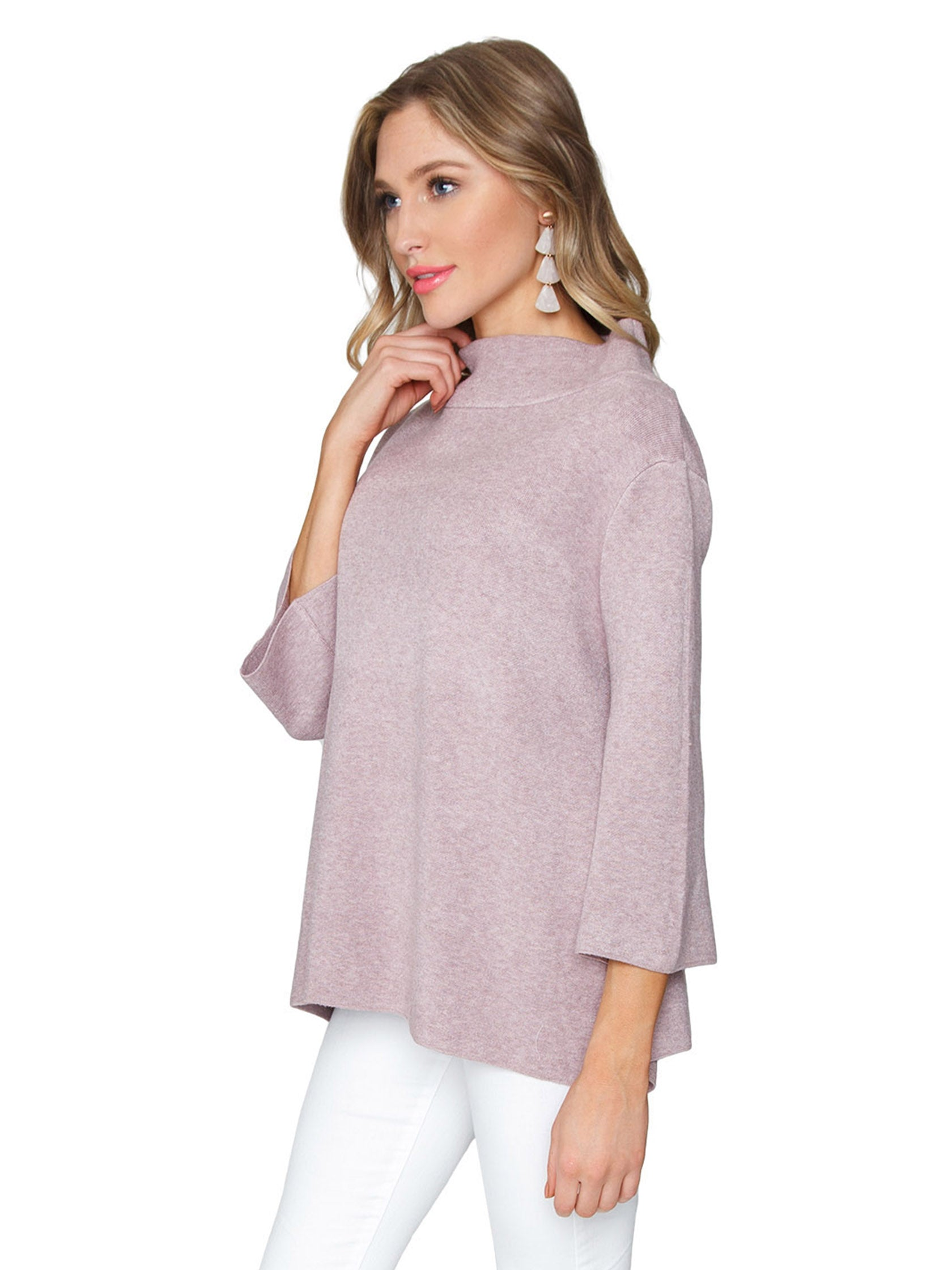 Women wearing a sweater rental from FashionPass called Mock Neck Pullover Sweater
