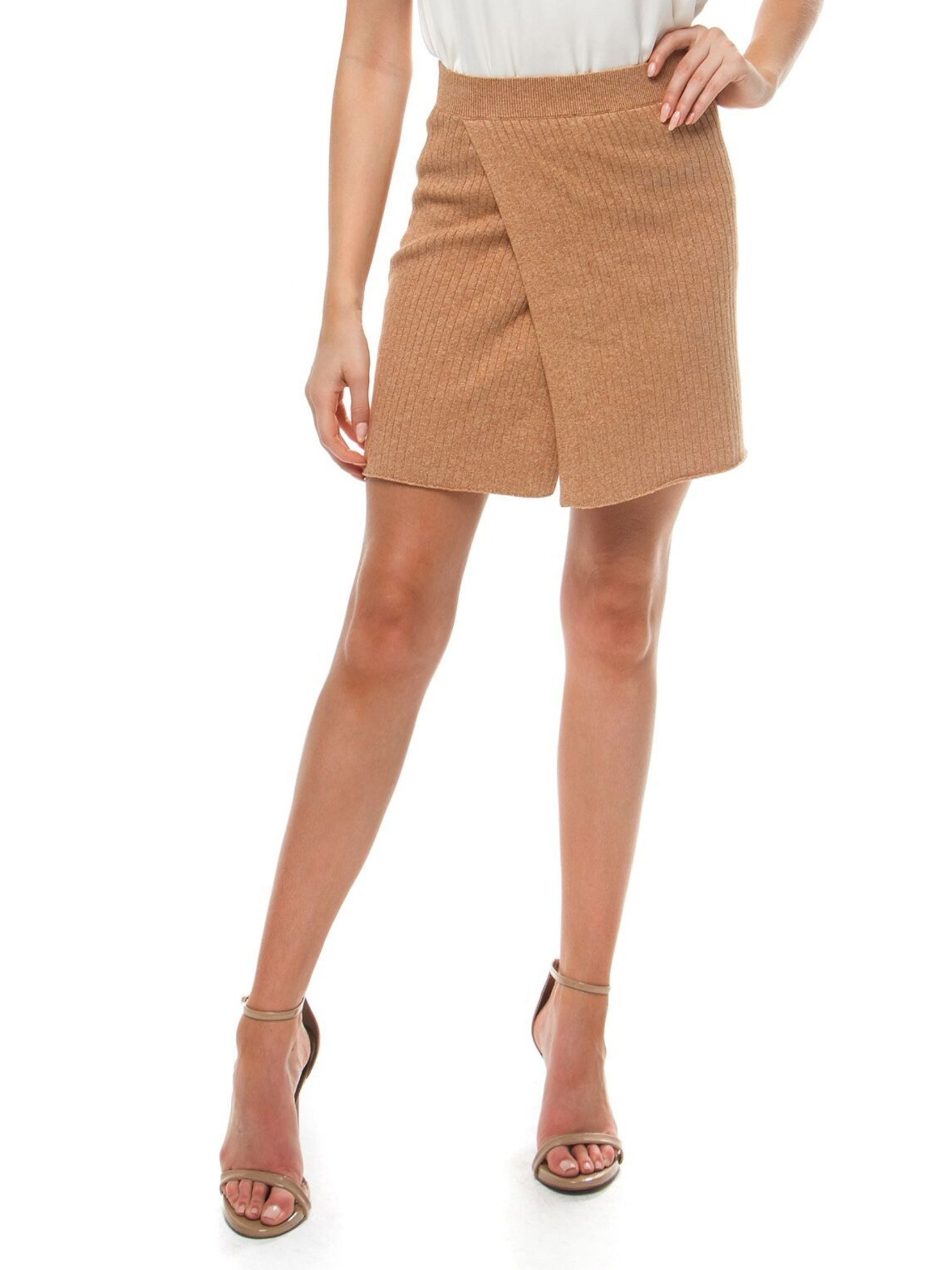 Woman wearing a skirt rental from Free People called Mod Wrap Skirt