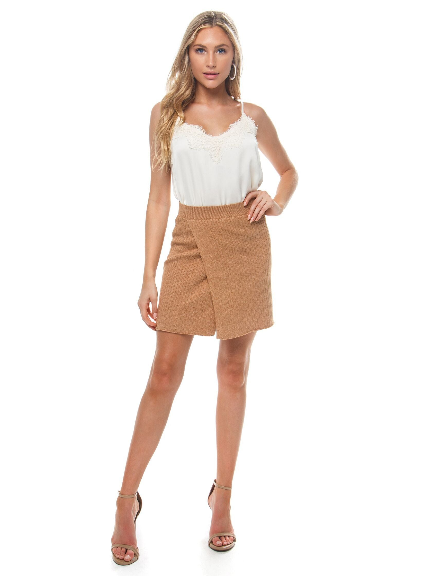 Girl wearing a skirt rental from Free People called Mod Wrap Skirt