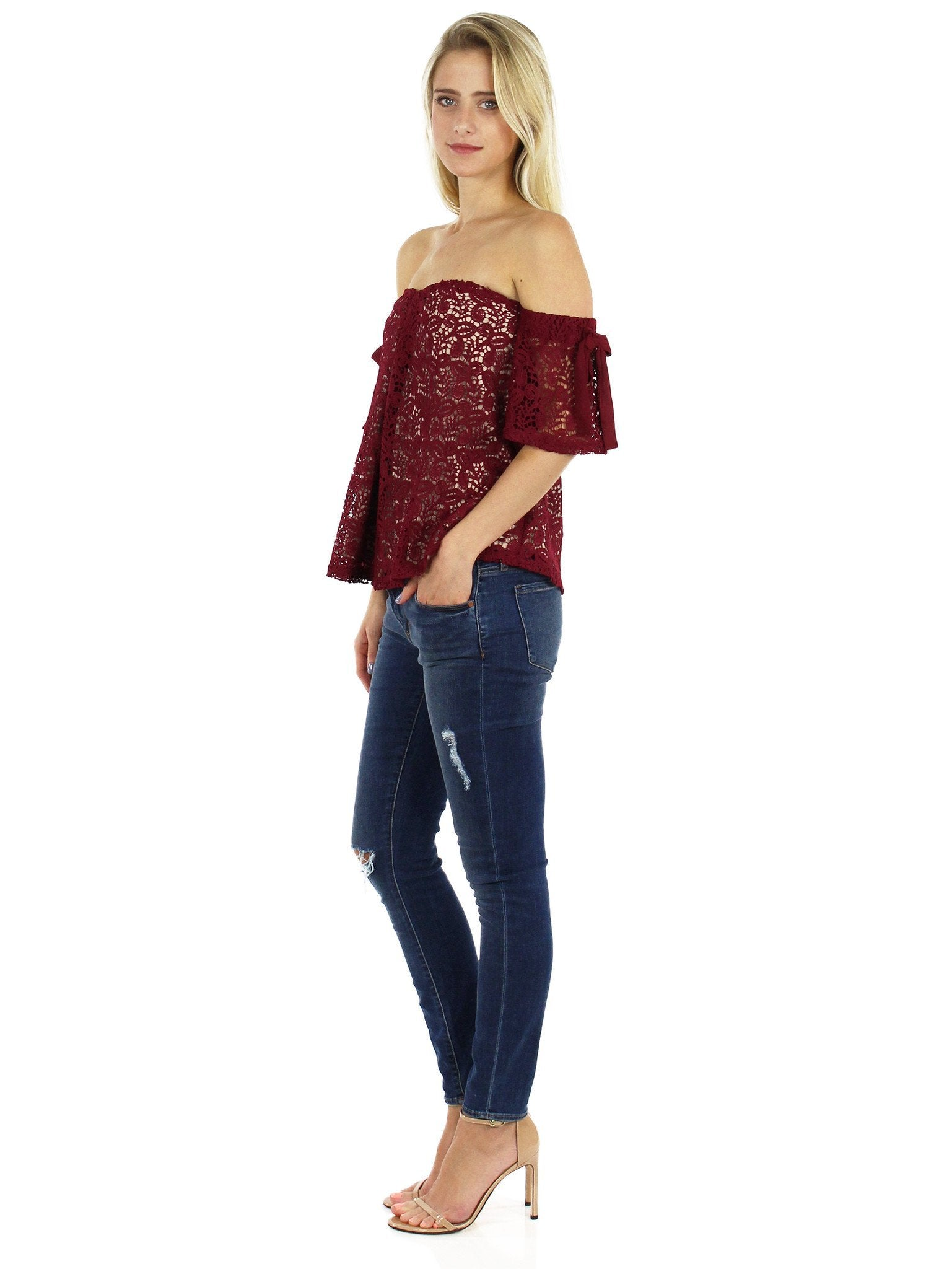 Women outfit in a top rental from Moon River called Off Shoulder Lace Top