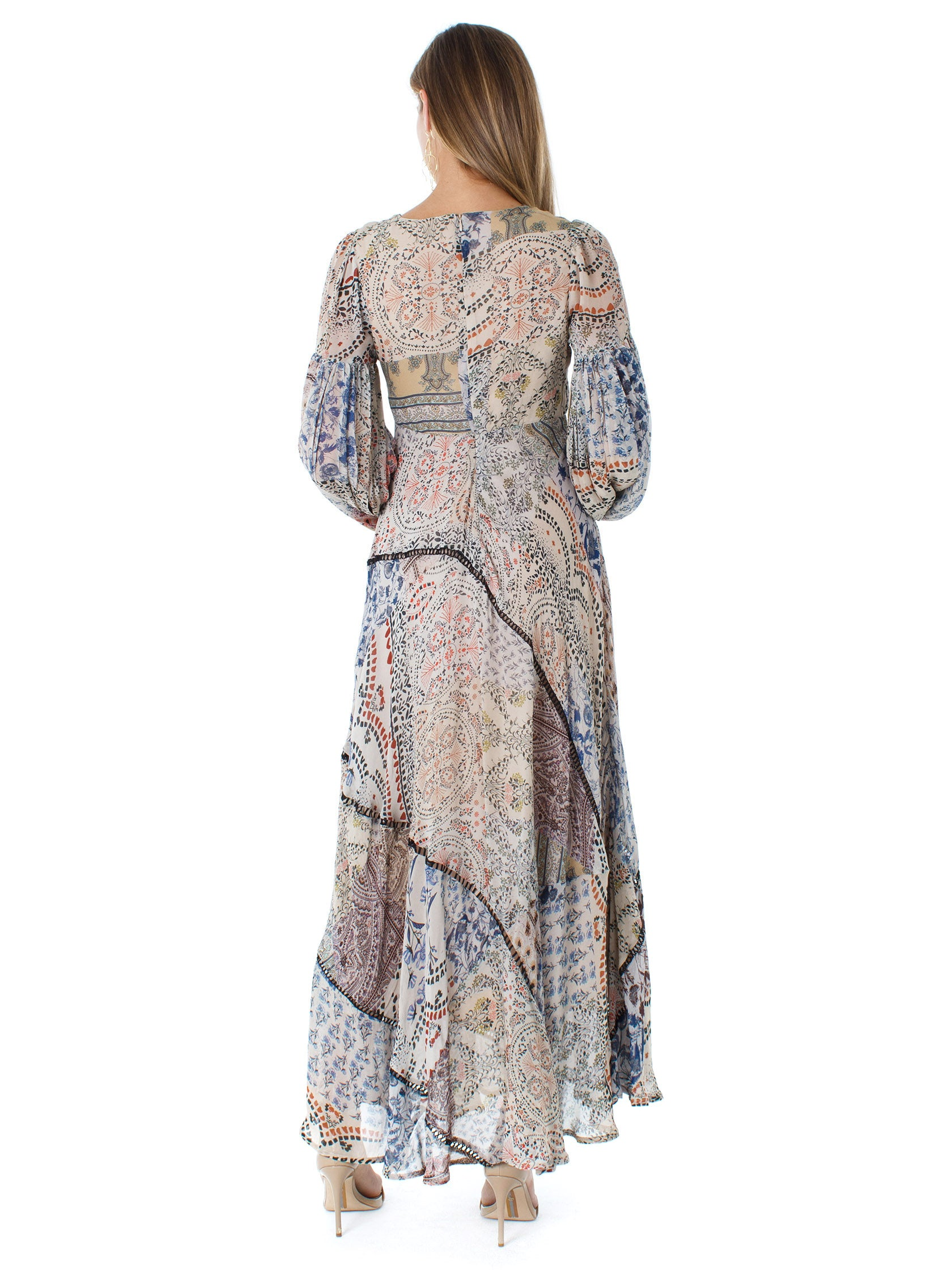 Women wearing a dress rental from Free People called Moroccan Dreams Maxi Dress