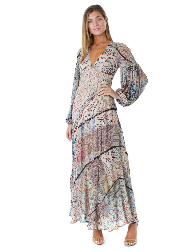 Girl wearing a dress rental from Free People called Cinched Sleeve Woodland Ditsy Wrap Dress