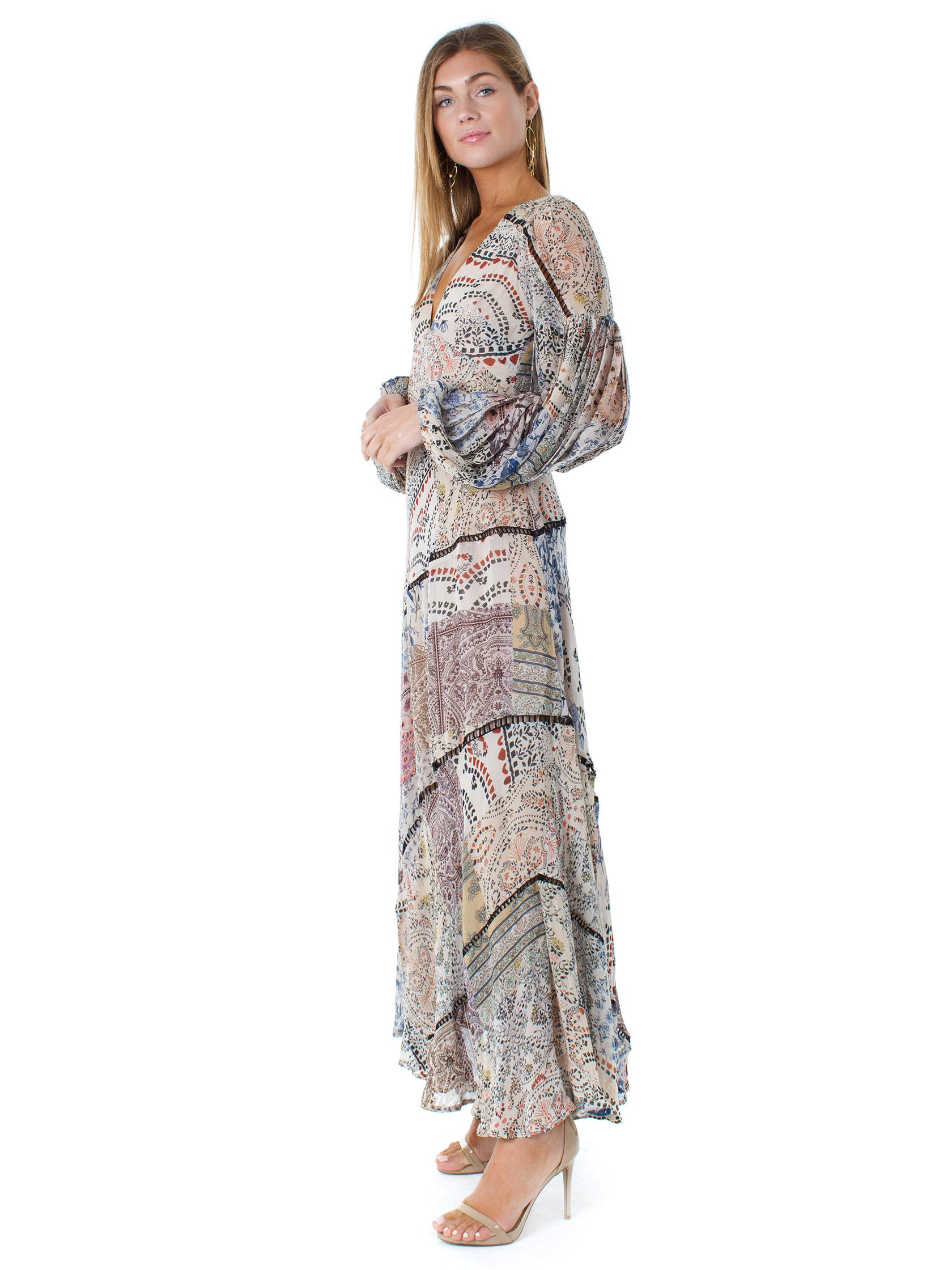 Woman wearing a dress rental from Free People called Moroccan Dreams Maxi Dress