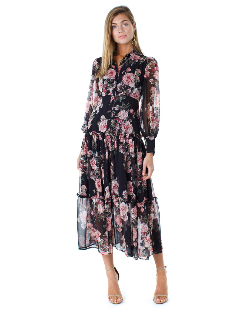 Woman wearing a dress rental from BARDOT called Cinched Sleeve Woodland Ditsy Wrap Dress
