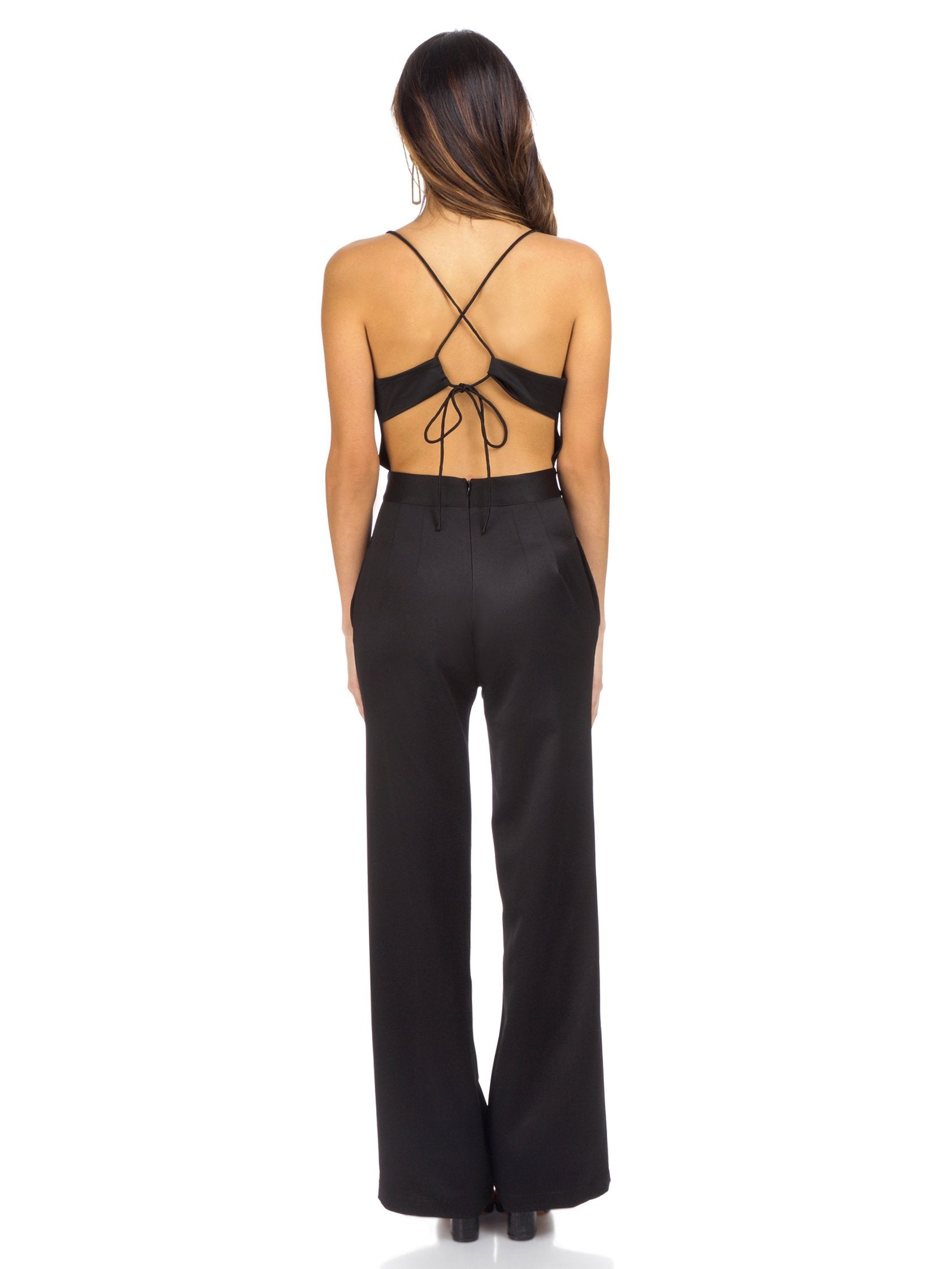Women wearing a jumpsuit rental from NBD called Diem Jumpsuit