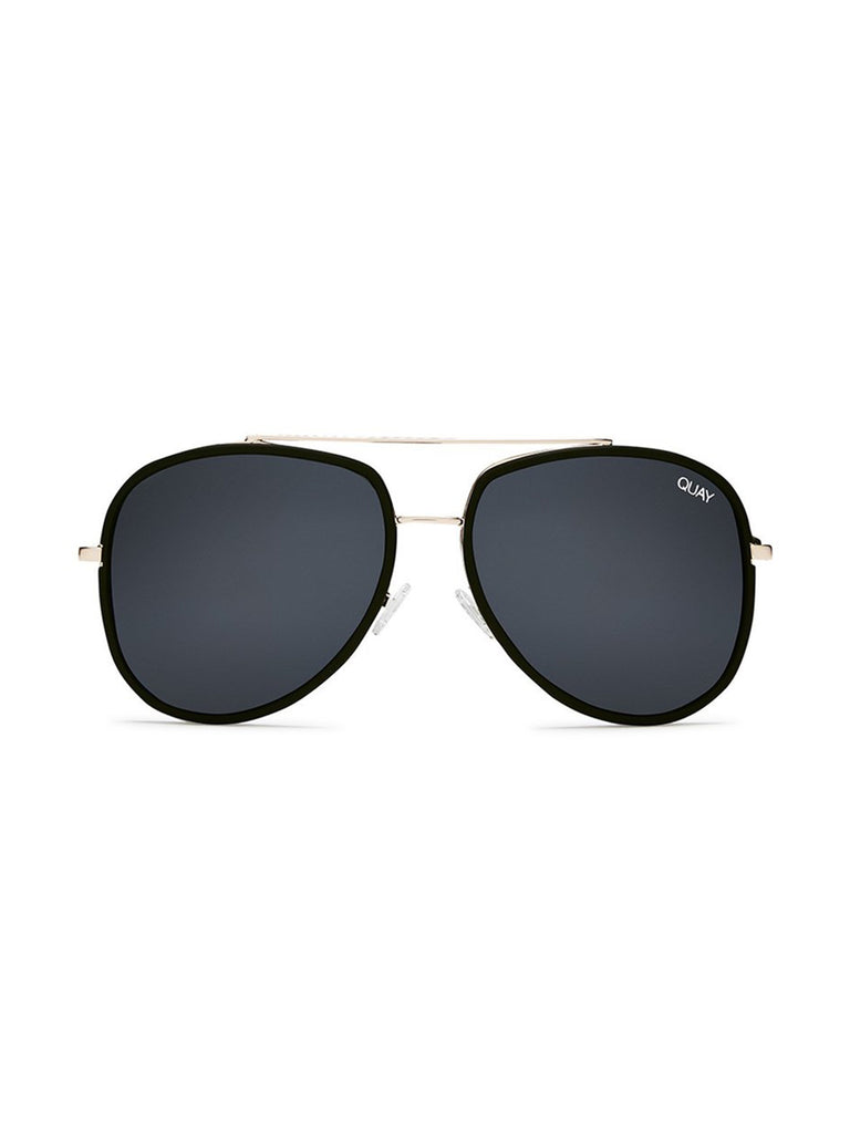 Girl wearing a sunglasses rental from Quay Australia called High Key Mini 57mm Aviator Sunglasses