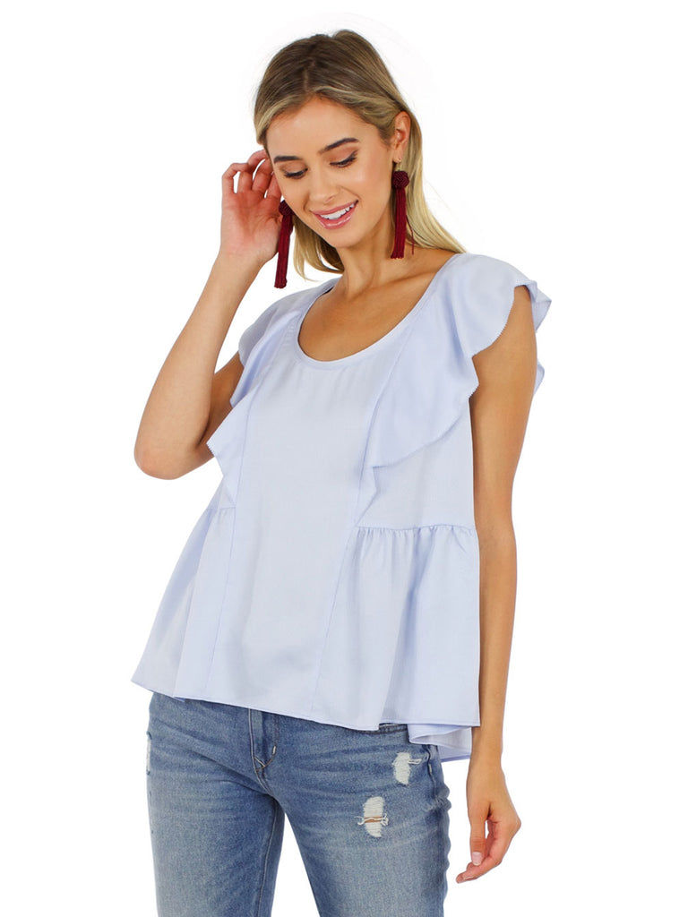 Woman wearing a top rental from French Connection called Neema Peplum Top