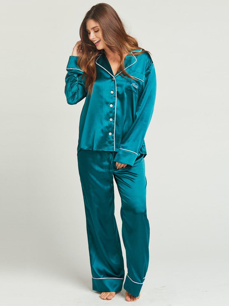 Women wearing a pajamas rental from Show Me Your Mumu called Campbell High Slit Pants