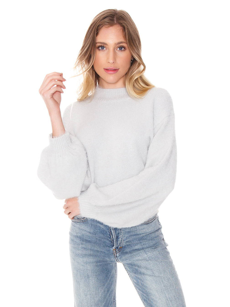 Girl wearing a sweater rental from FashionPass called Long Sleeve That's A Wrap Crop Top