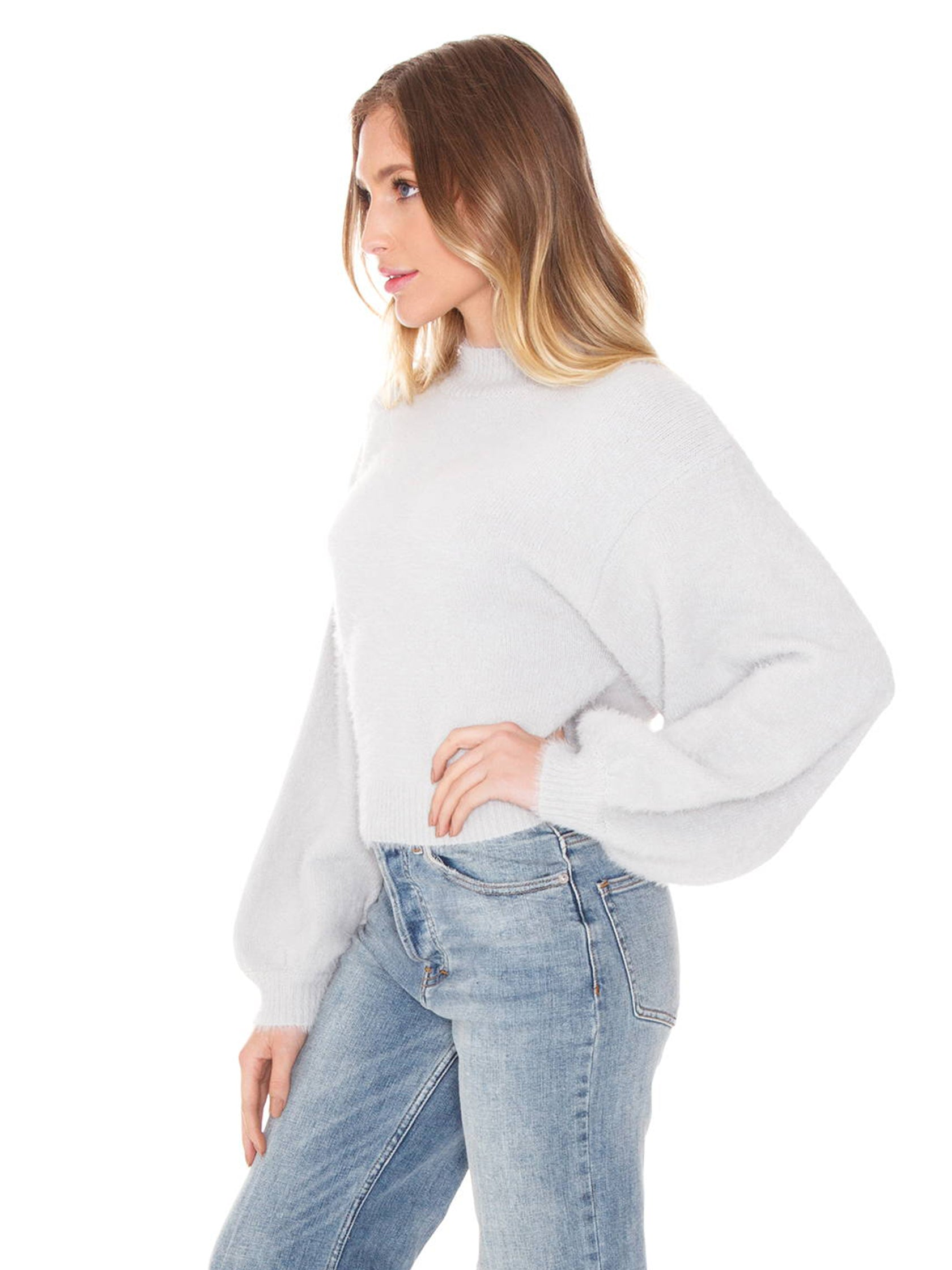 Women wearing a sweater rental from FashionPass called Nicole Sweater