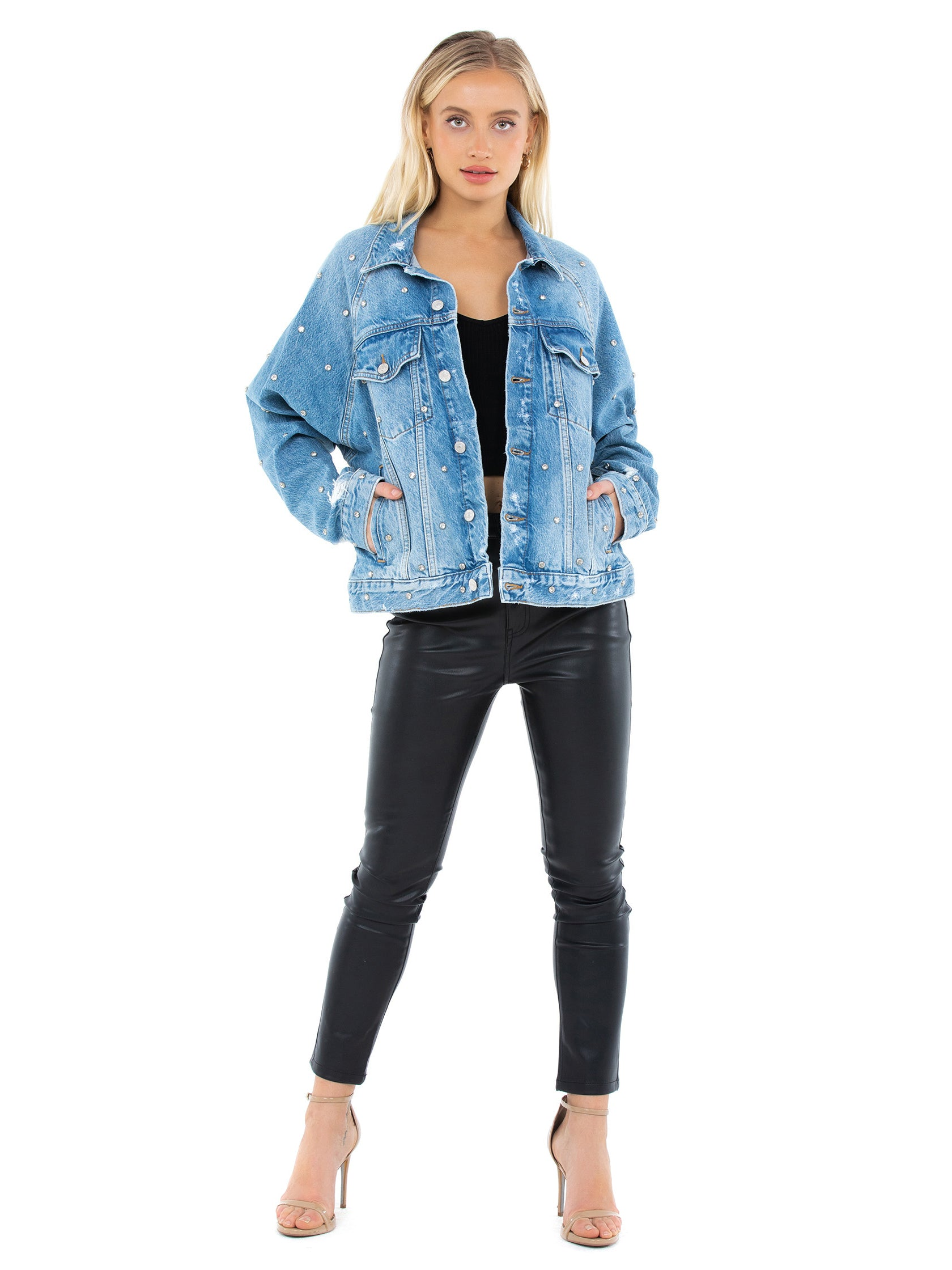 Girl wearing a jacket rental from Free People called Night After Night Denim Jacket