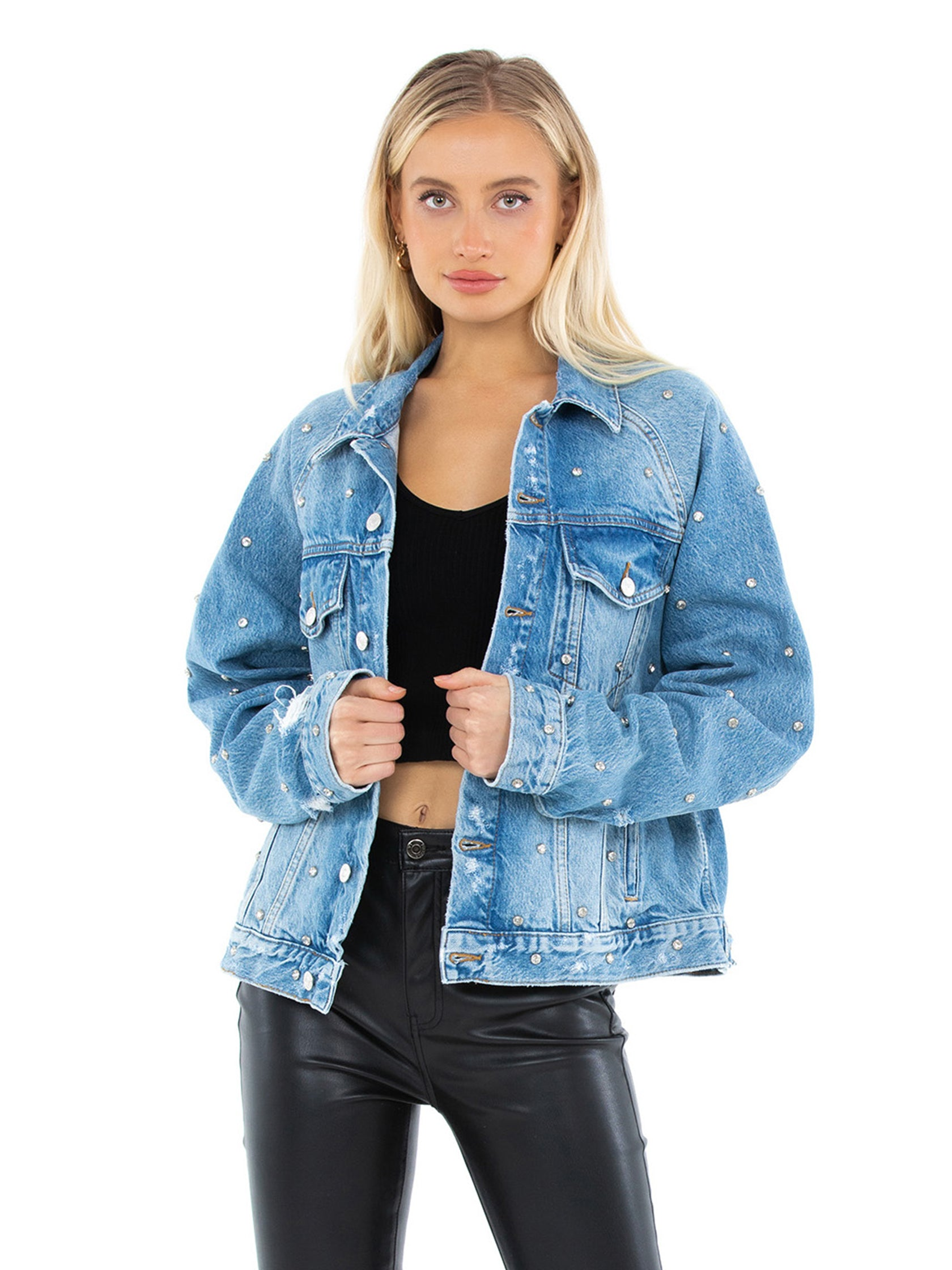 Woman wearing a jacket rental from Free People called Night After Night Denim Jacket